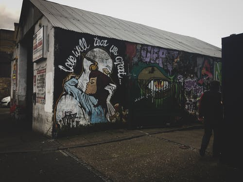 White Shed With Wall Art and Graffiti