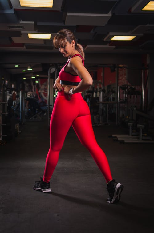 Woman in Red Yoga Pants Inside Gym