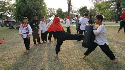 Free stock photo of boy, girl, kick