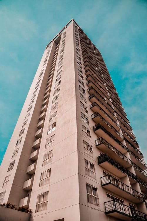 Low-angle Photography of Brown Concrete High-rise Building