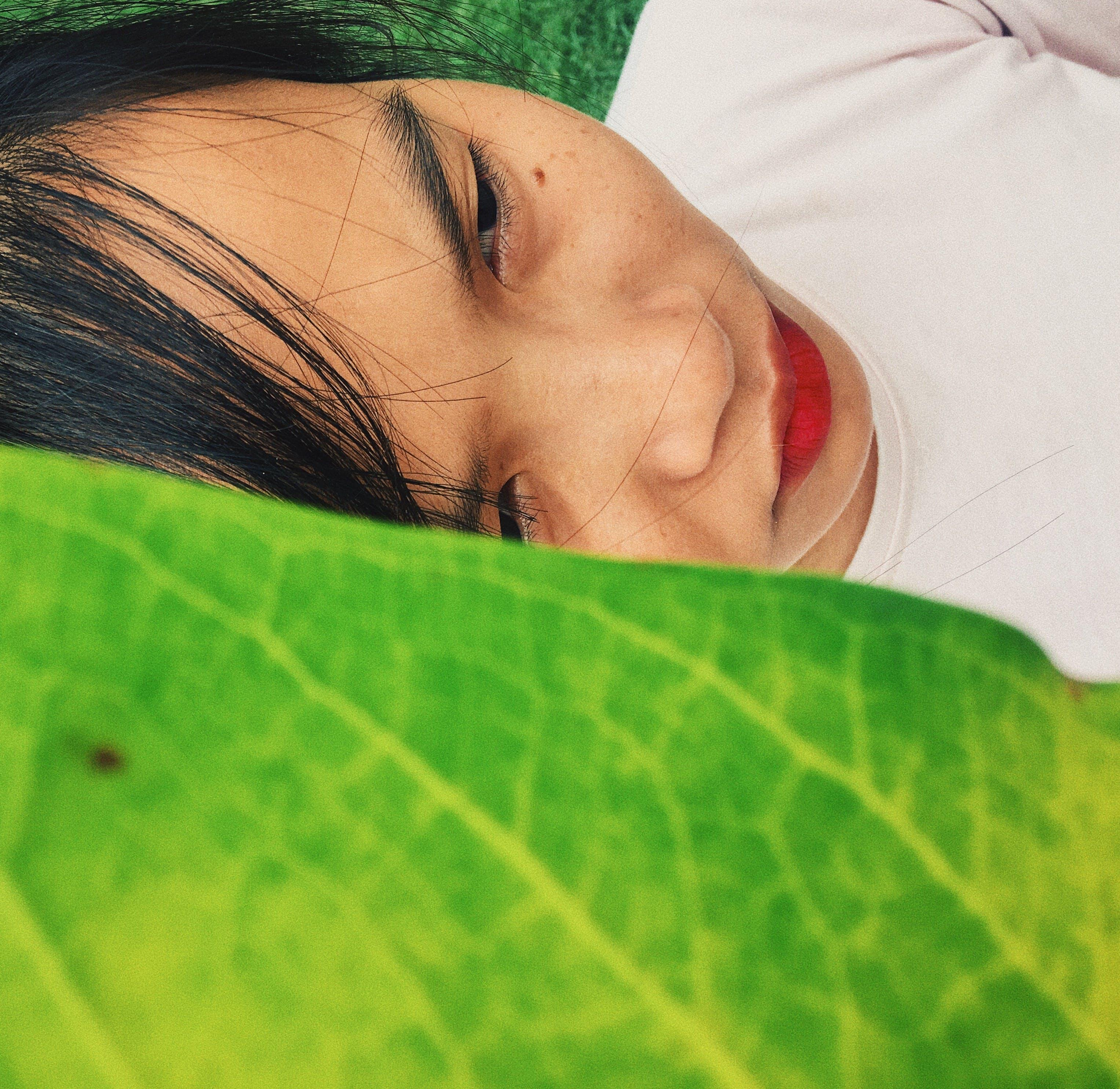 Person Behind Green Leaf