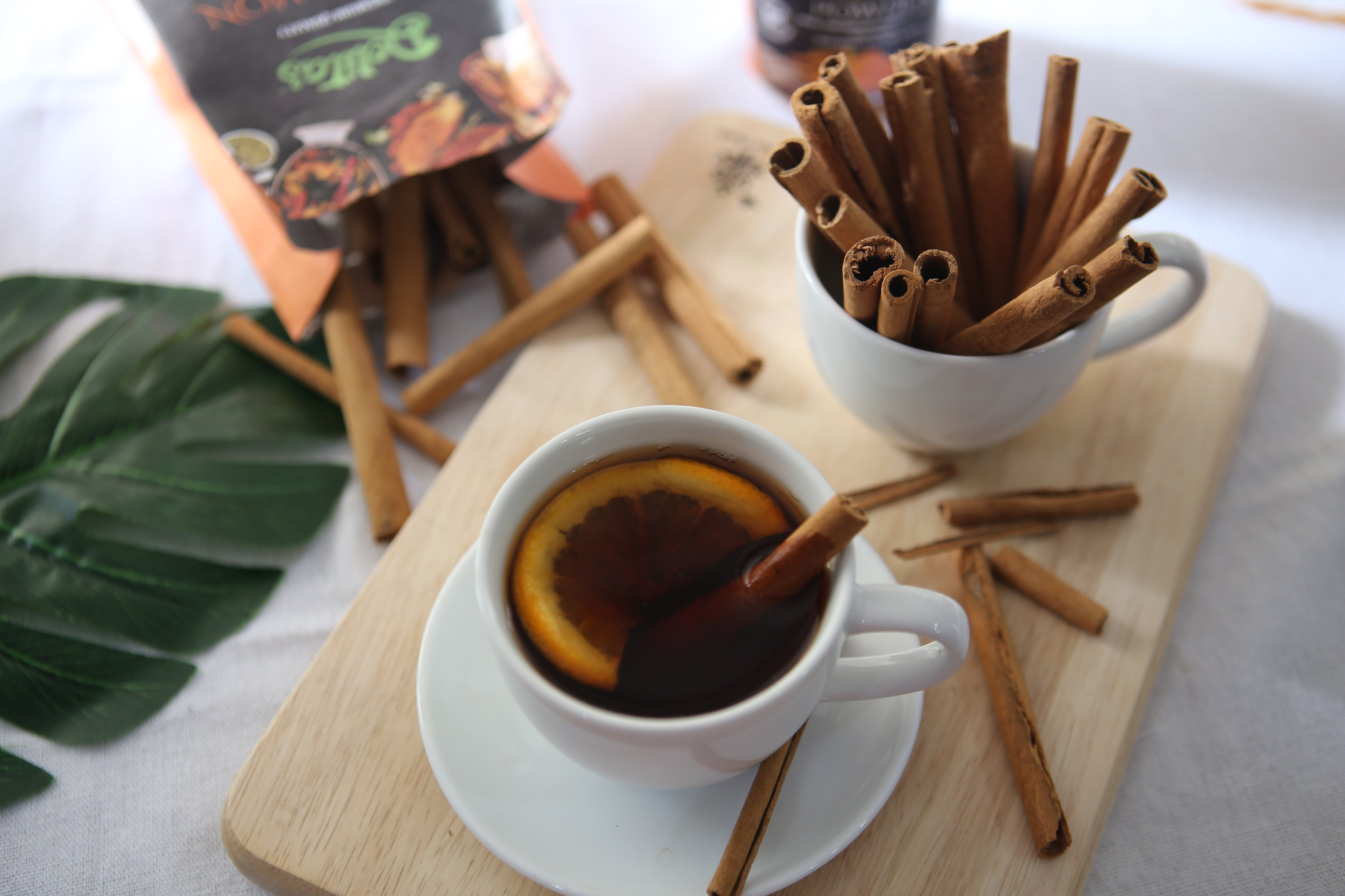 Photography of Cinnamon Sticks on Cup