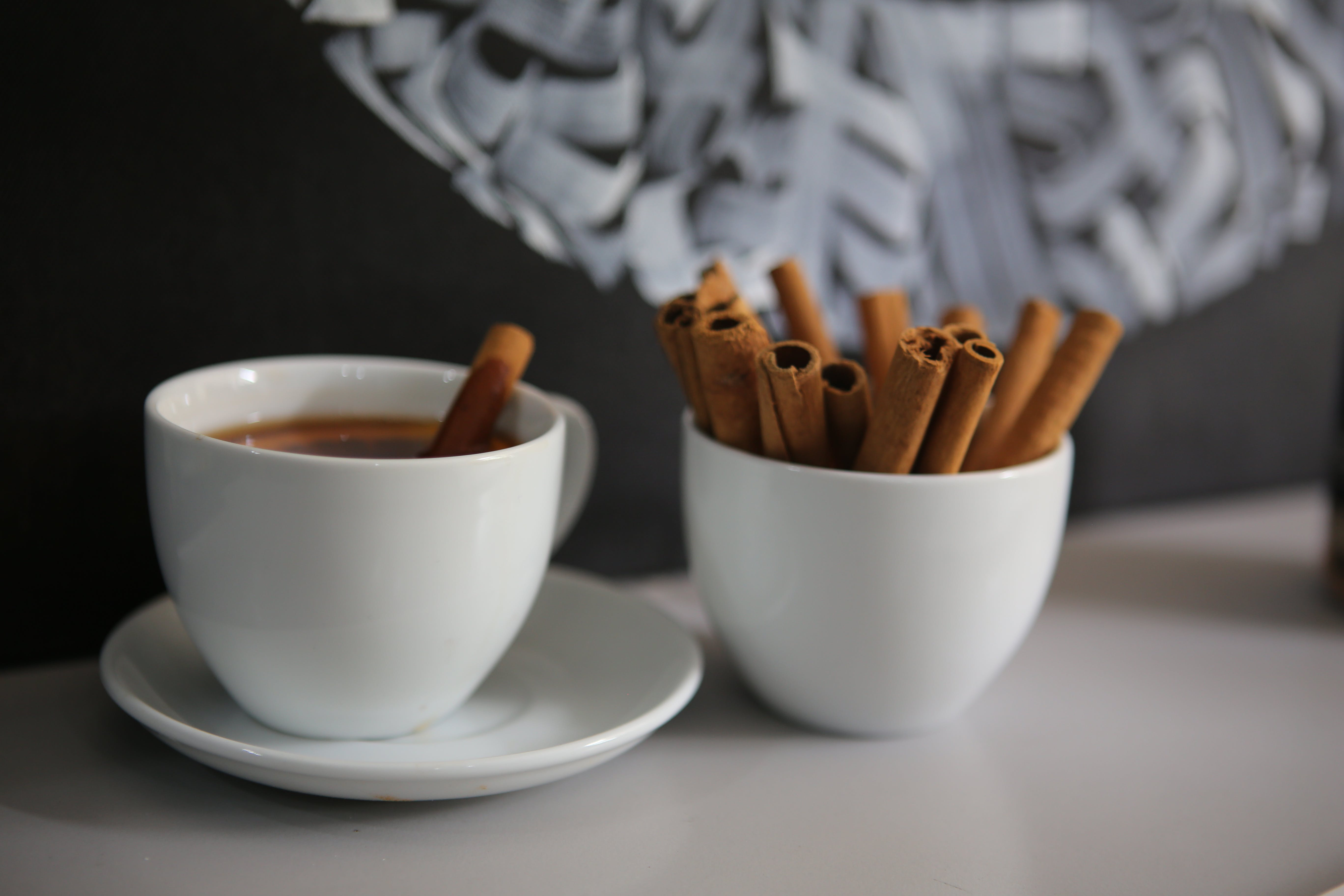 Chocolate Sticks on Two White Ceramic Cups