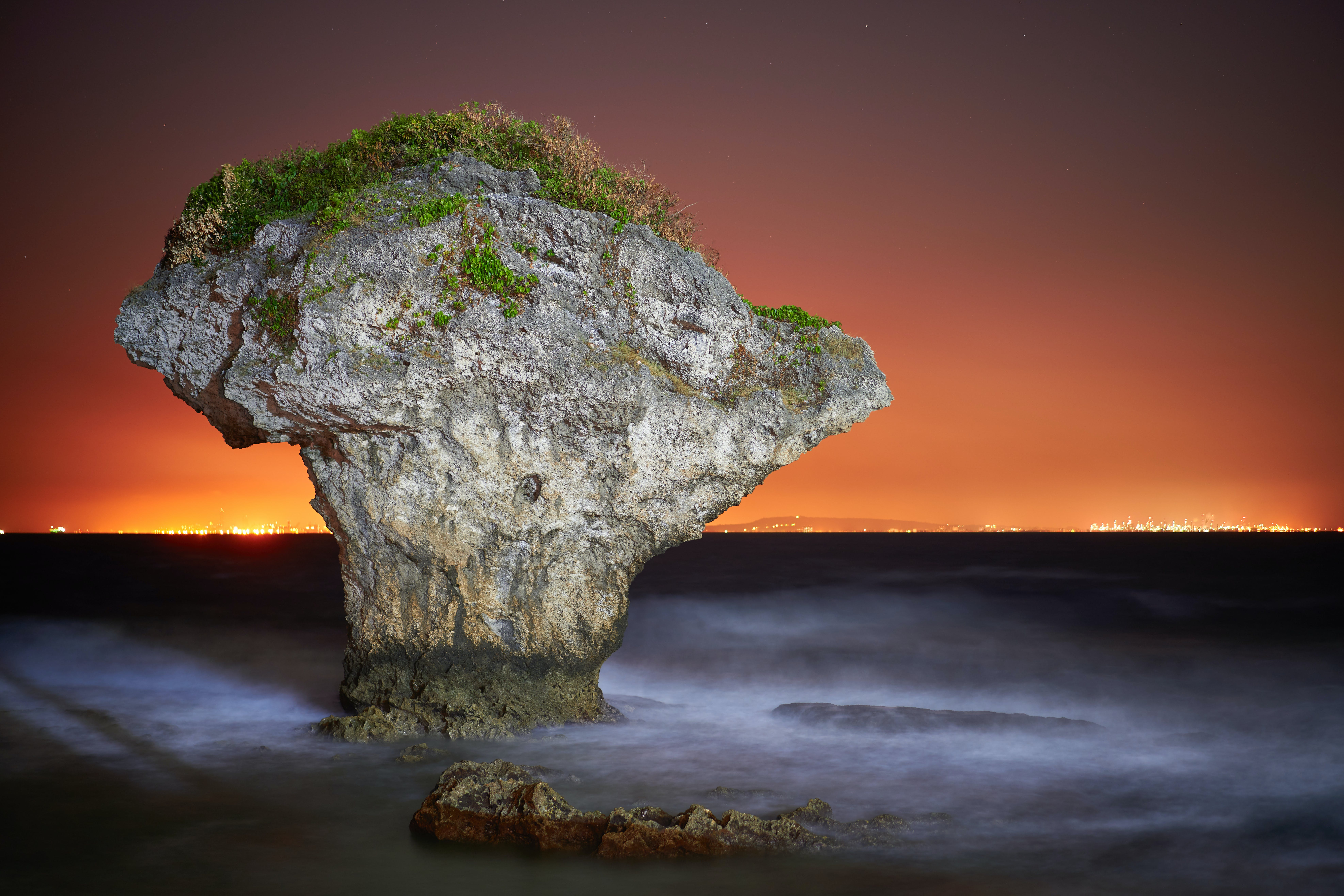 Rock Formation Surrounded By Body Of Water