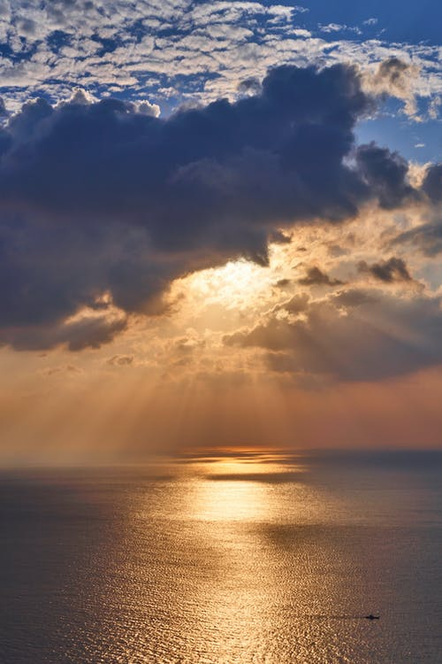 Seascape Under Sunlight Covered by Clouds