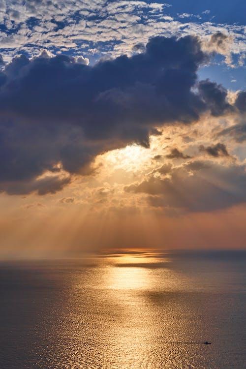 Fotos de stock gratuitas de agua, cielo al atardecer, horizonte, luz del sol