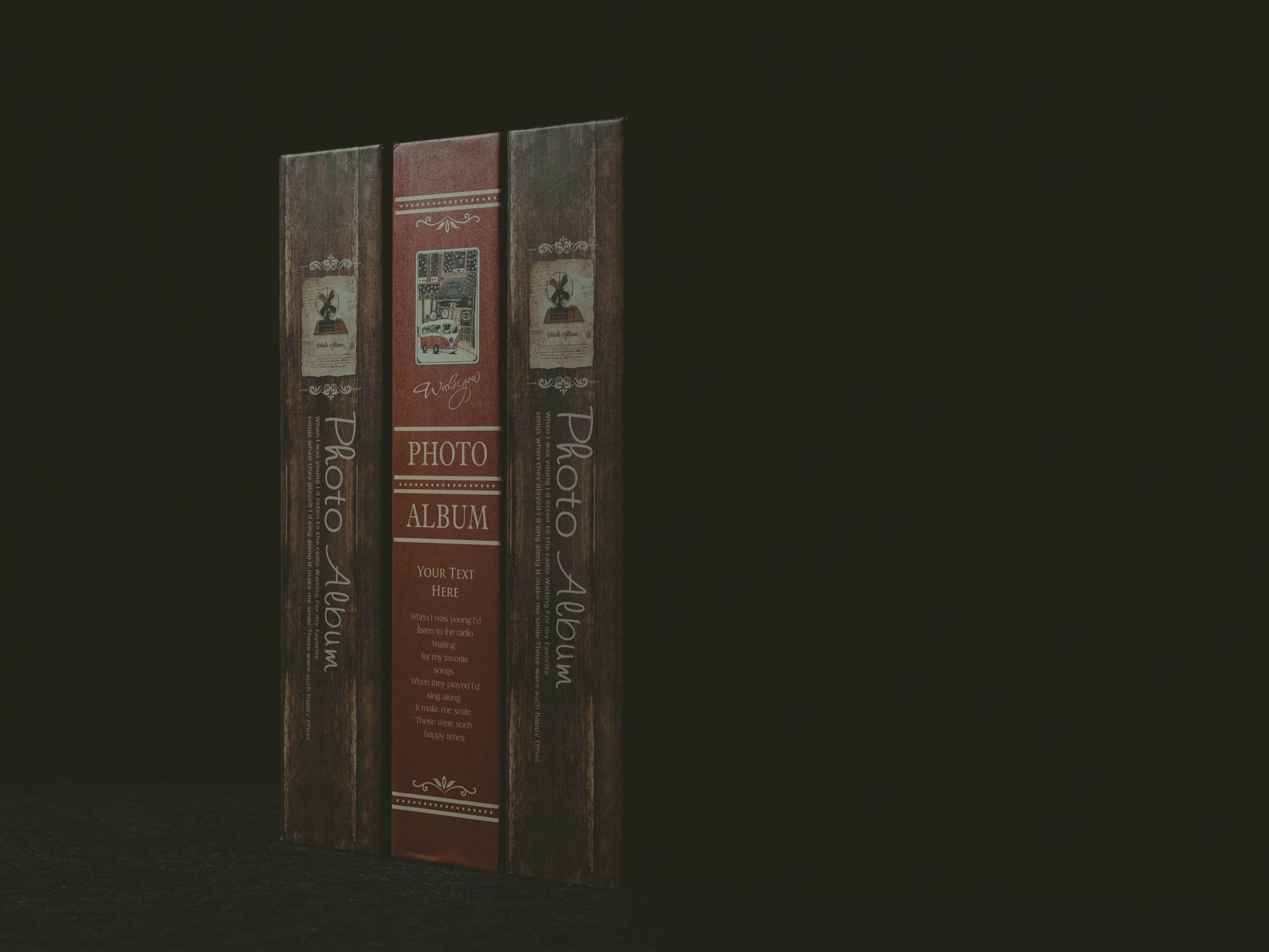Three Paperback Books on Black Surface