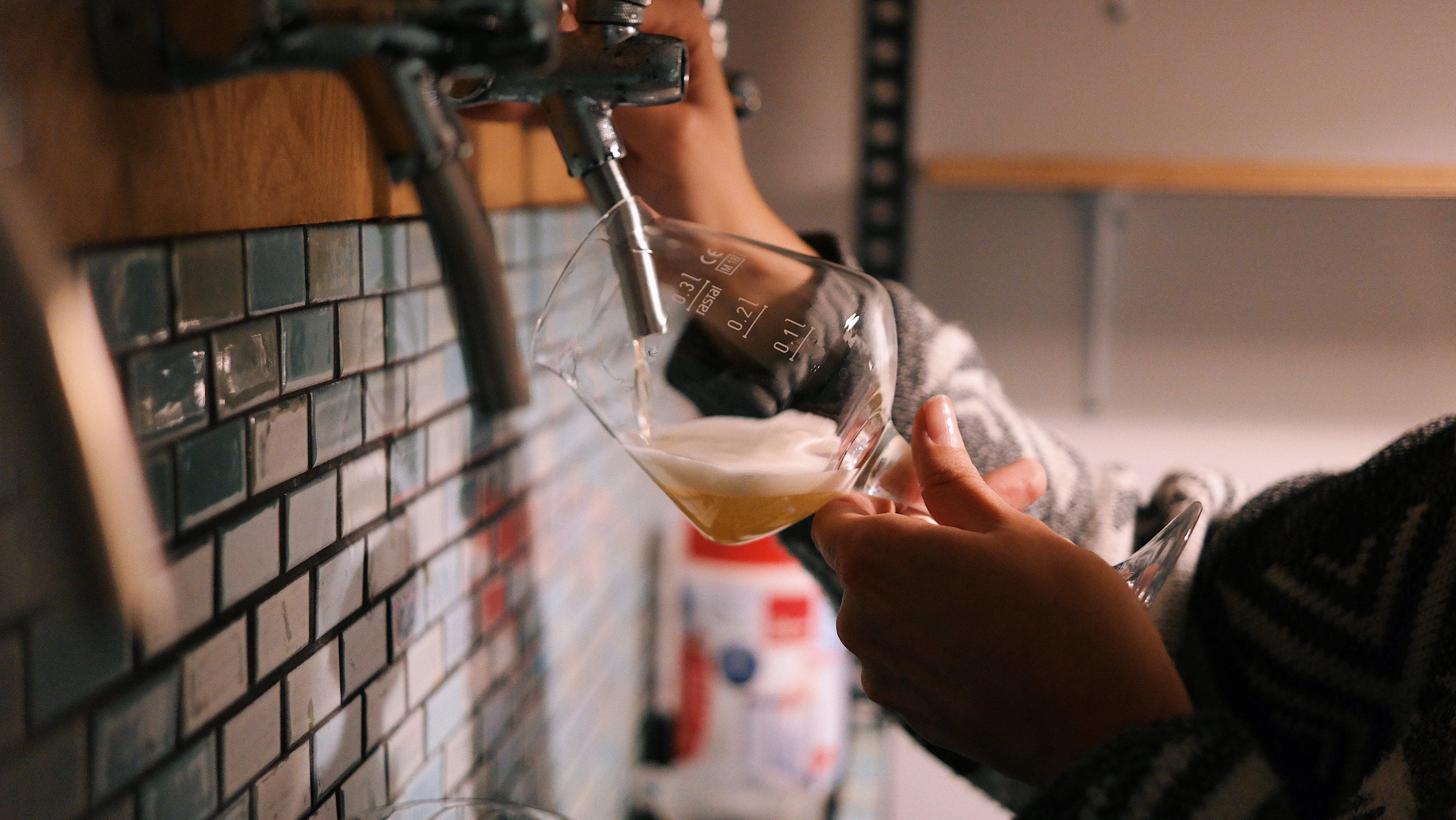 Person Holding Wine Glass Refilling Soda