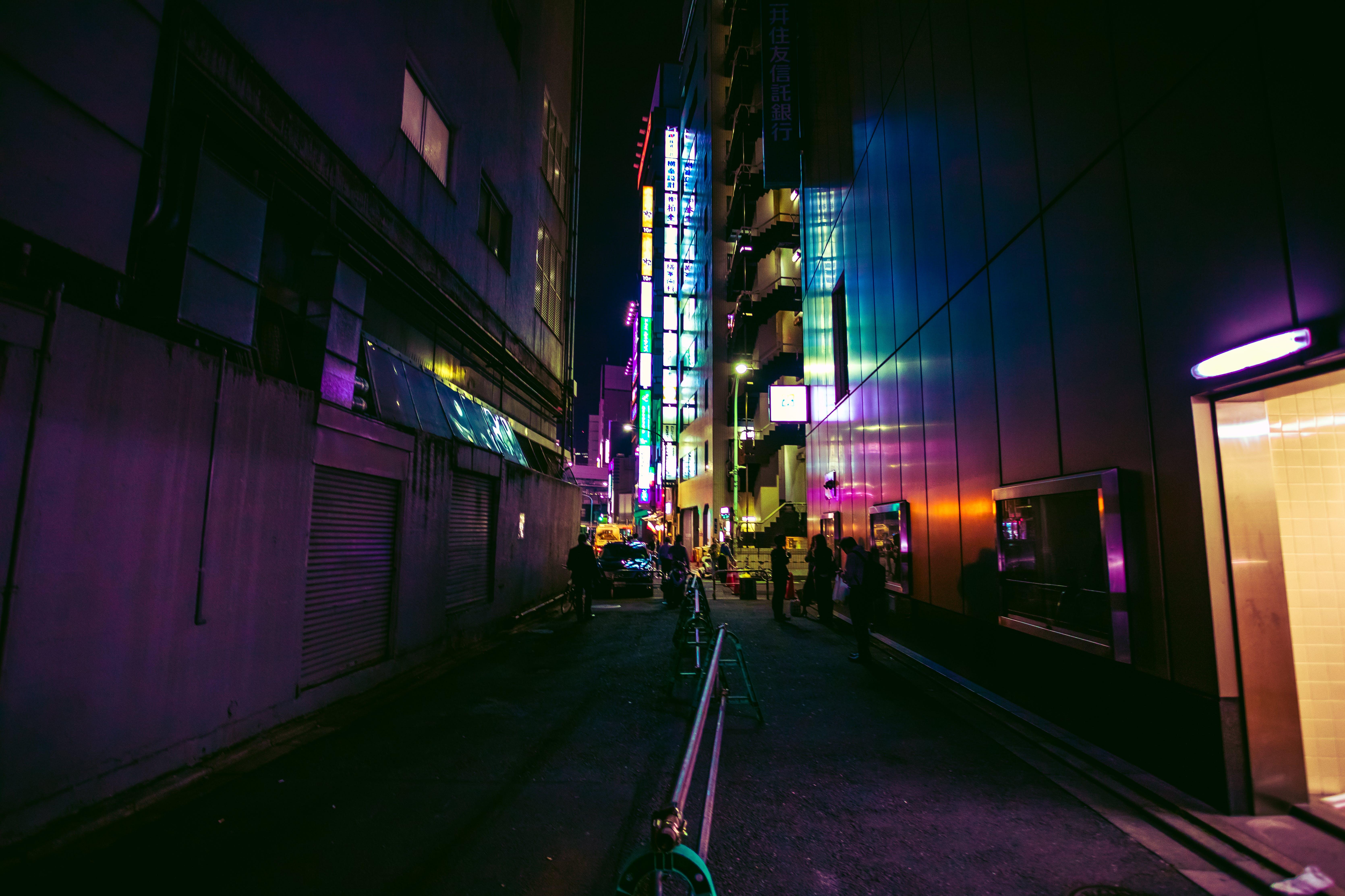 Photo of People Walking In Alley