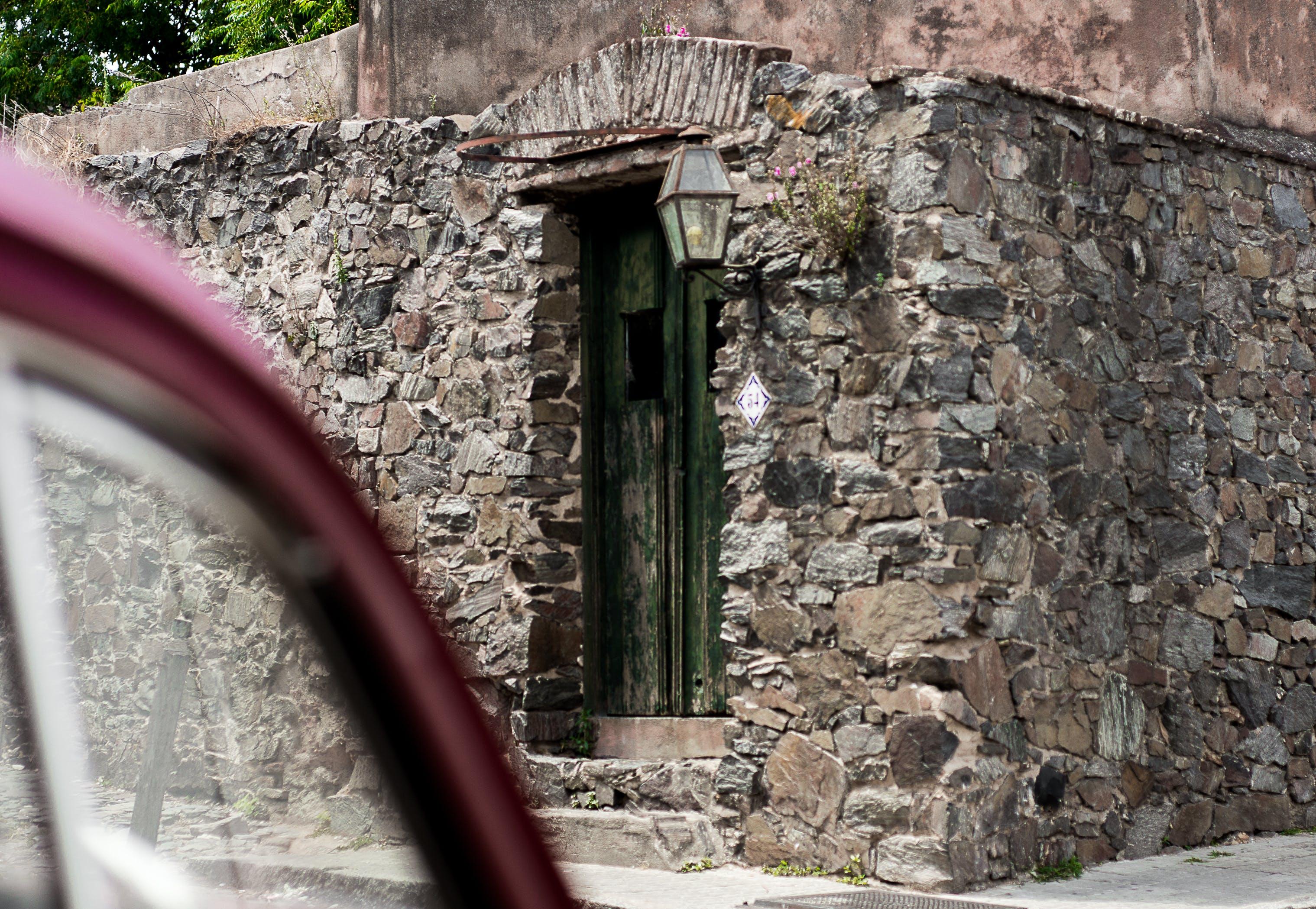 Free stock photo of brick wall, color, door, empty street
