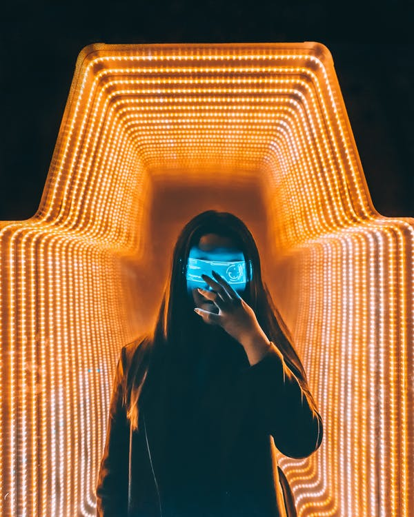 Person in Black Top Inside Orange Lighted Room