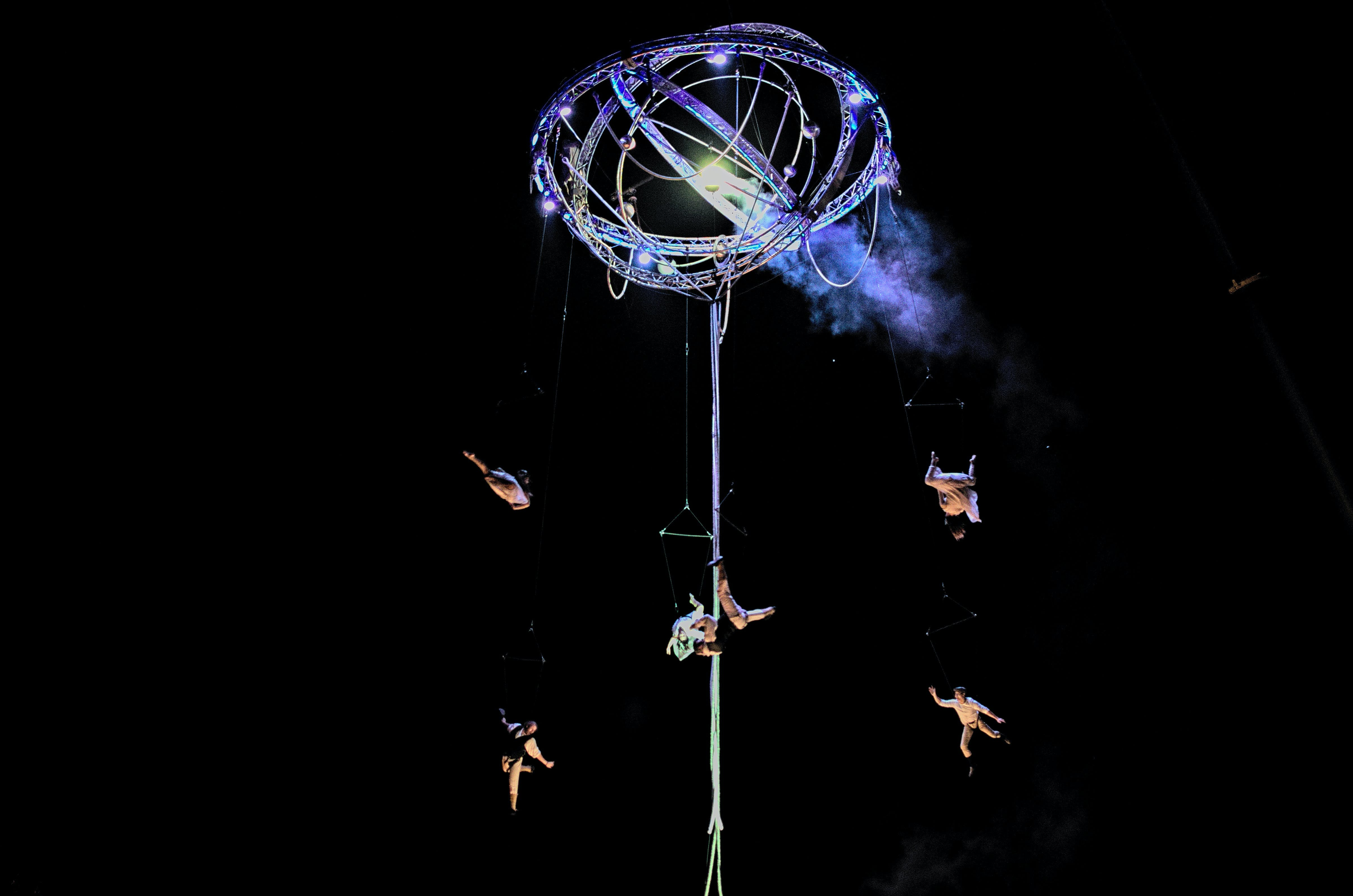 Acrobats Performing on Tower