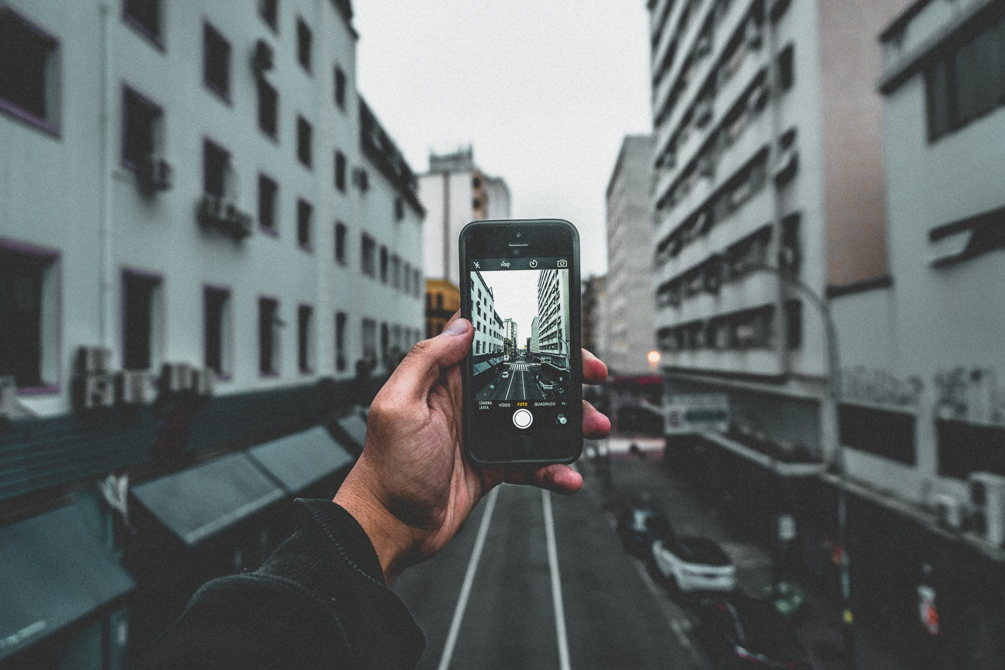 Man Holding Smartphone Capturing Roadway