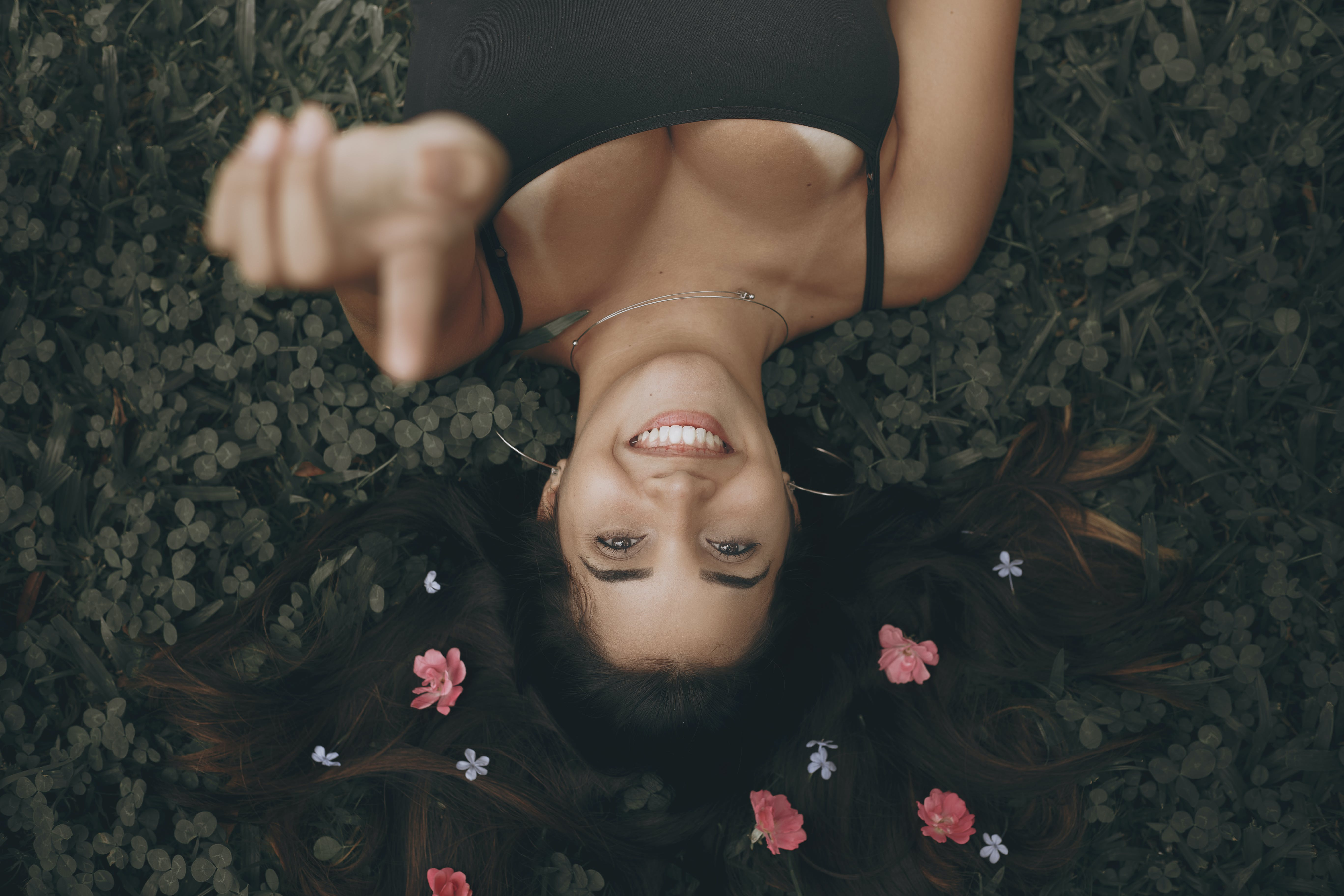 Top View Photo of Woman Laying On Grass