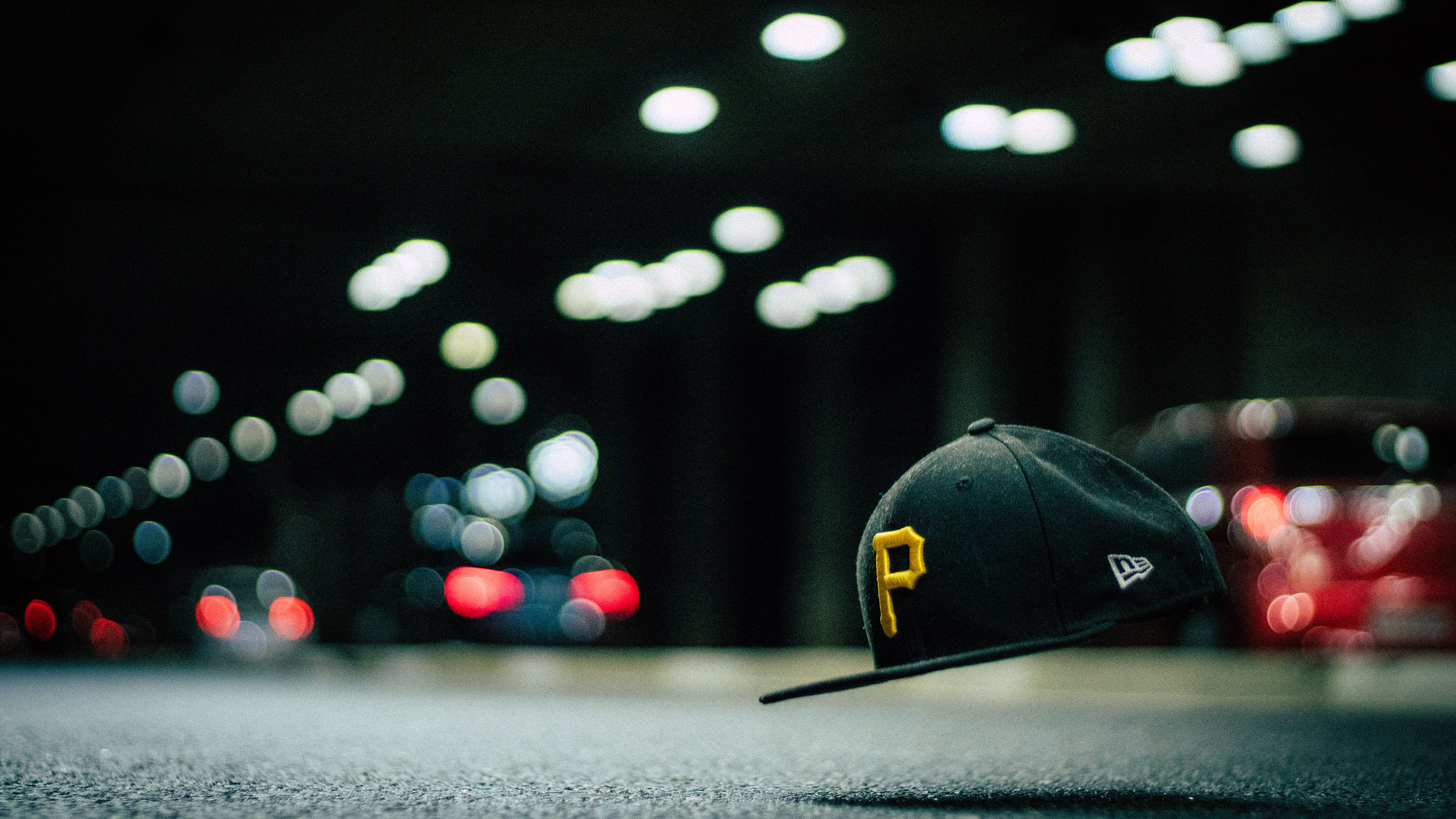 Black and Yellow P Cap Hanging in the Air