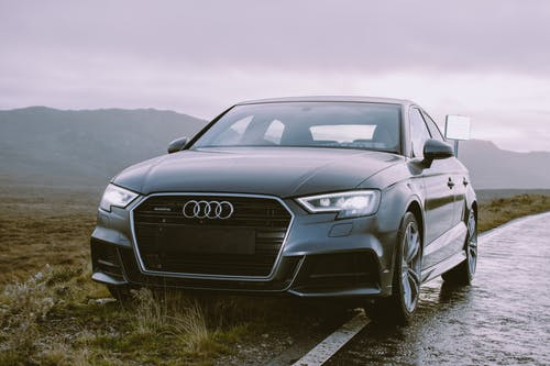 Grey Audi Sedan Parked Beside Road