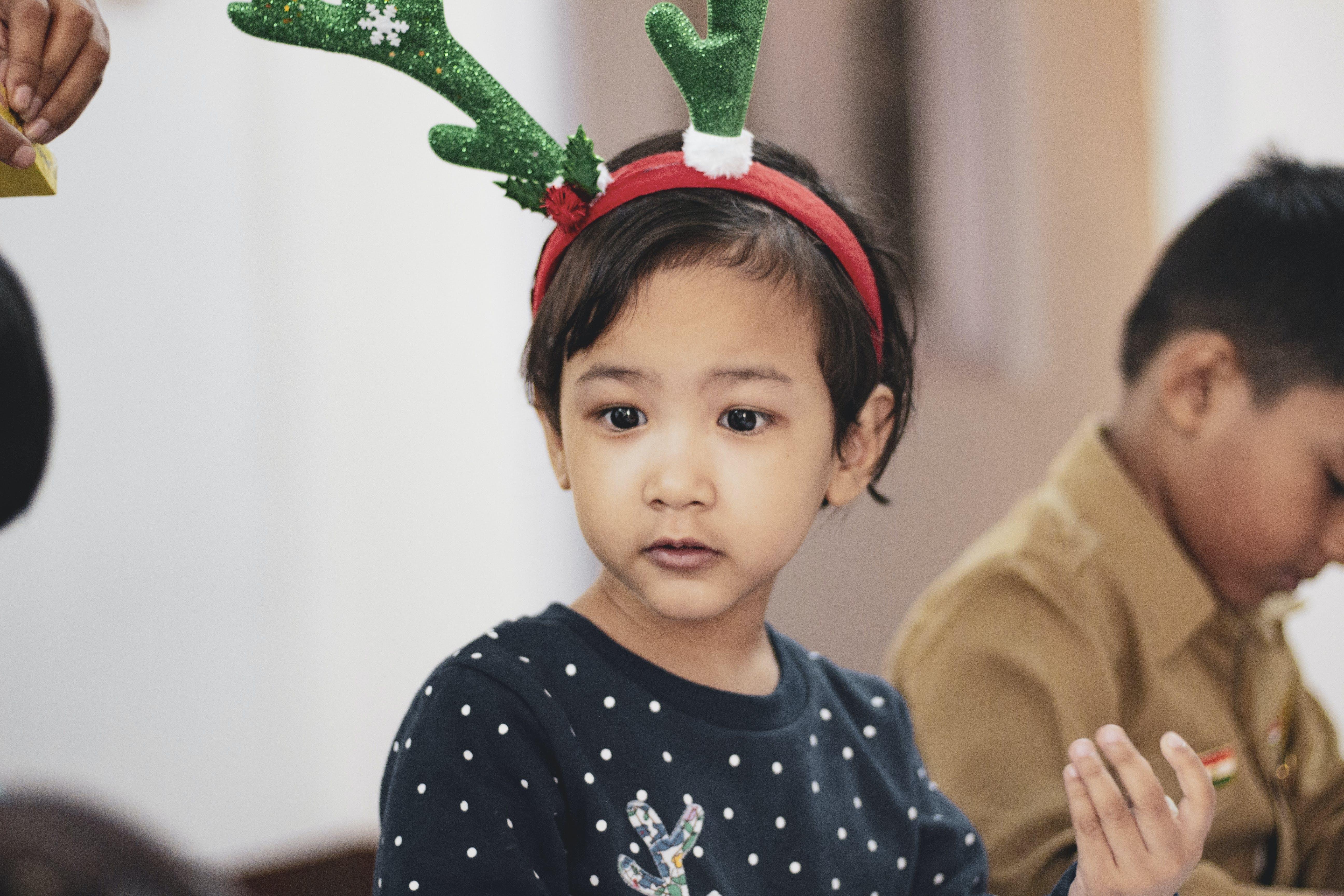 Girl Wearing Reindeer Headband