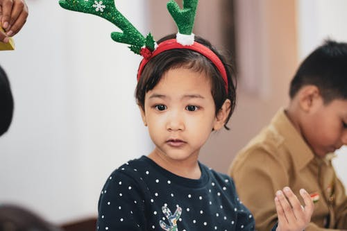 Girl Wearing Reindeer Headband