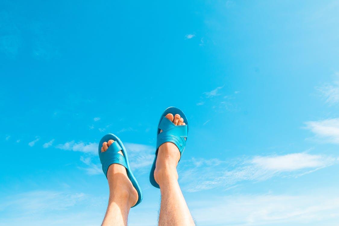 Person Wearing Blue Slide Sandals Under Blue