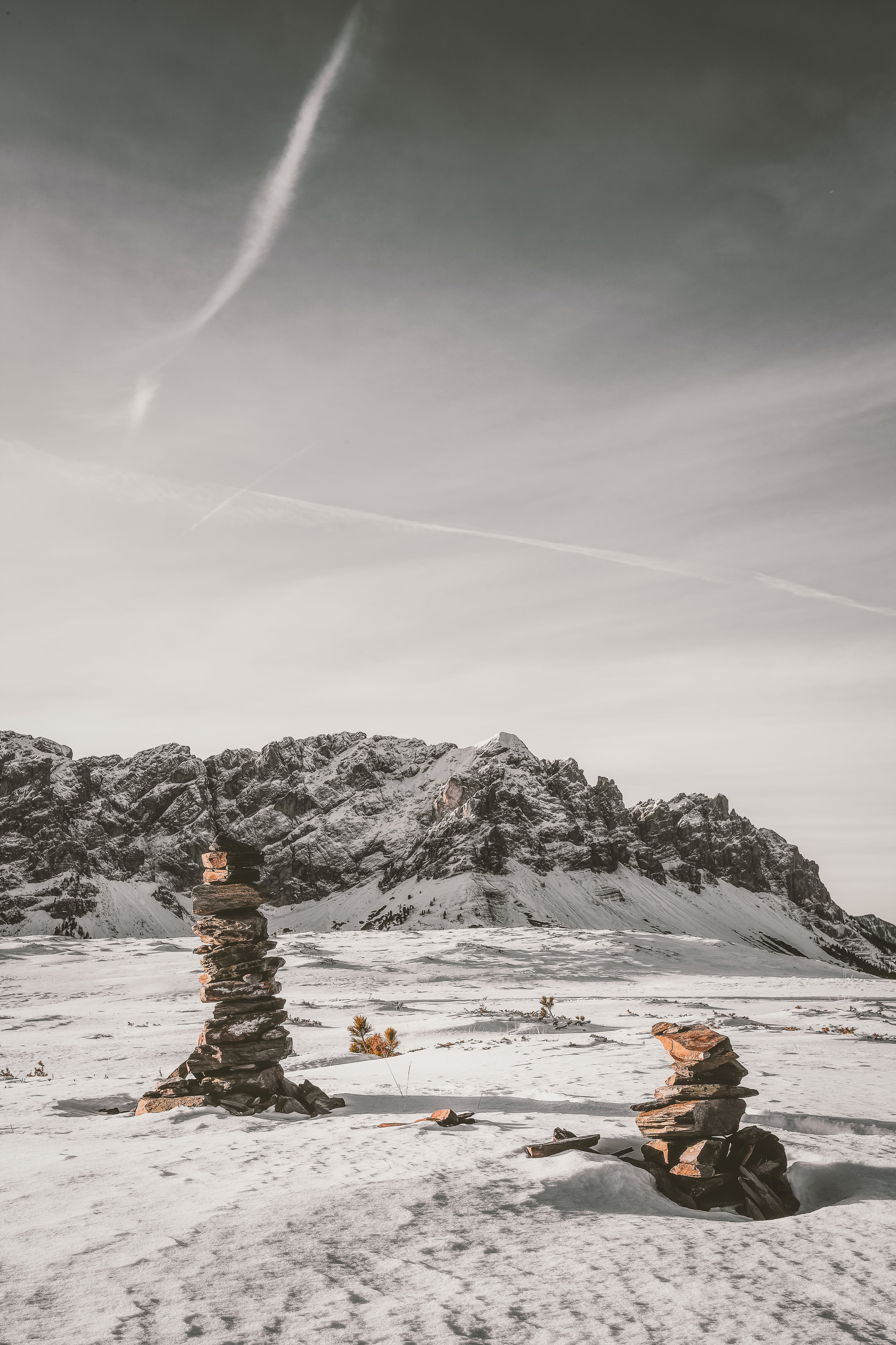 Stack of Stones on Snow Covered Field