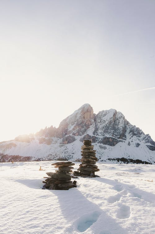 Stacks Of Stones Surrounded By Snow