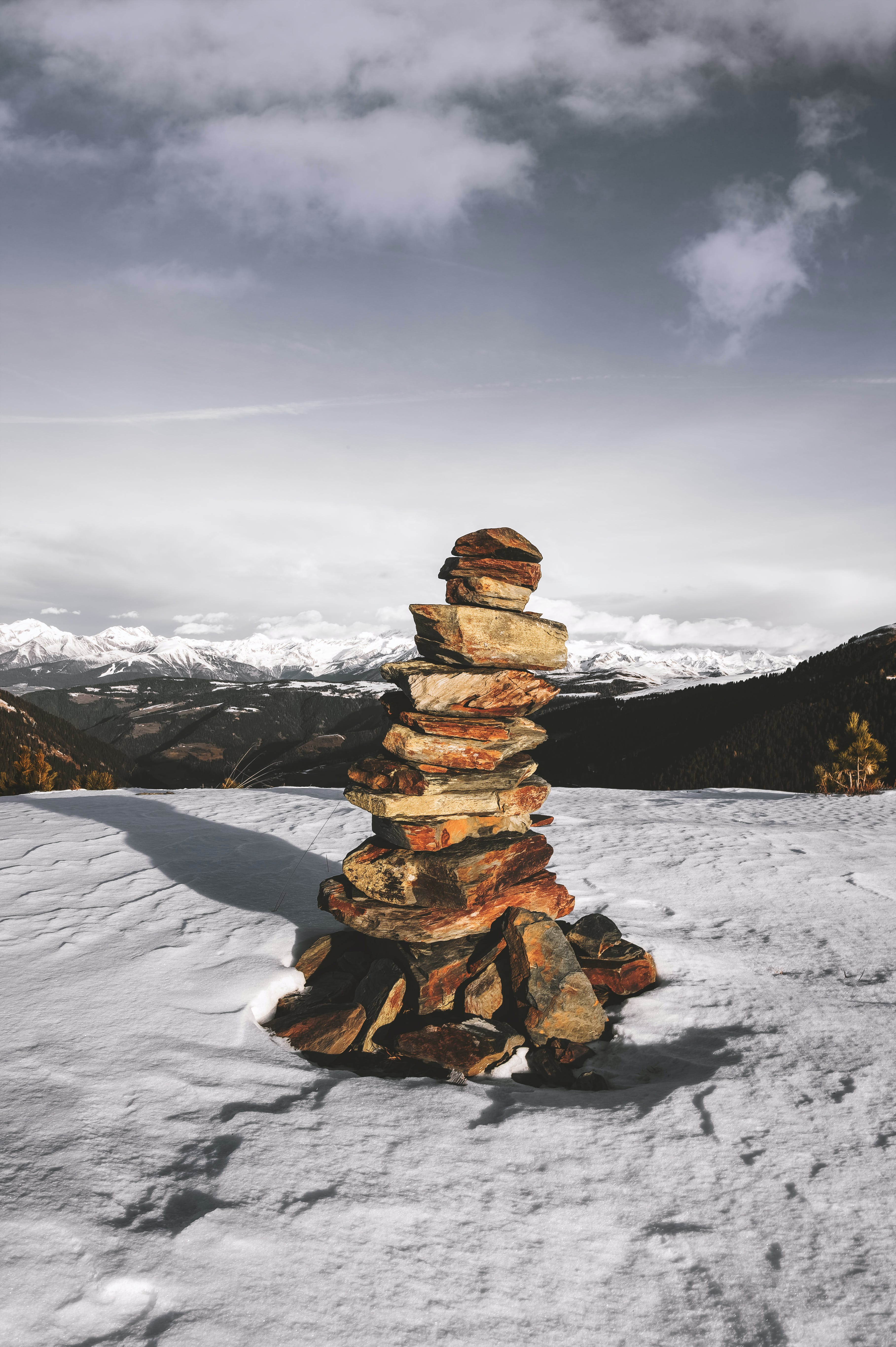 Stack Of Stones On Snow