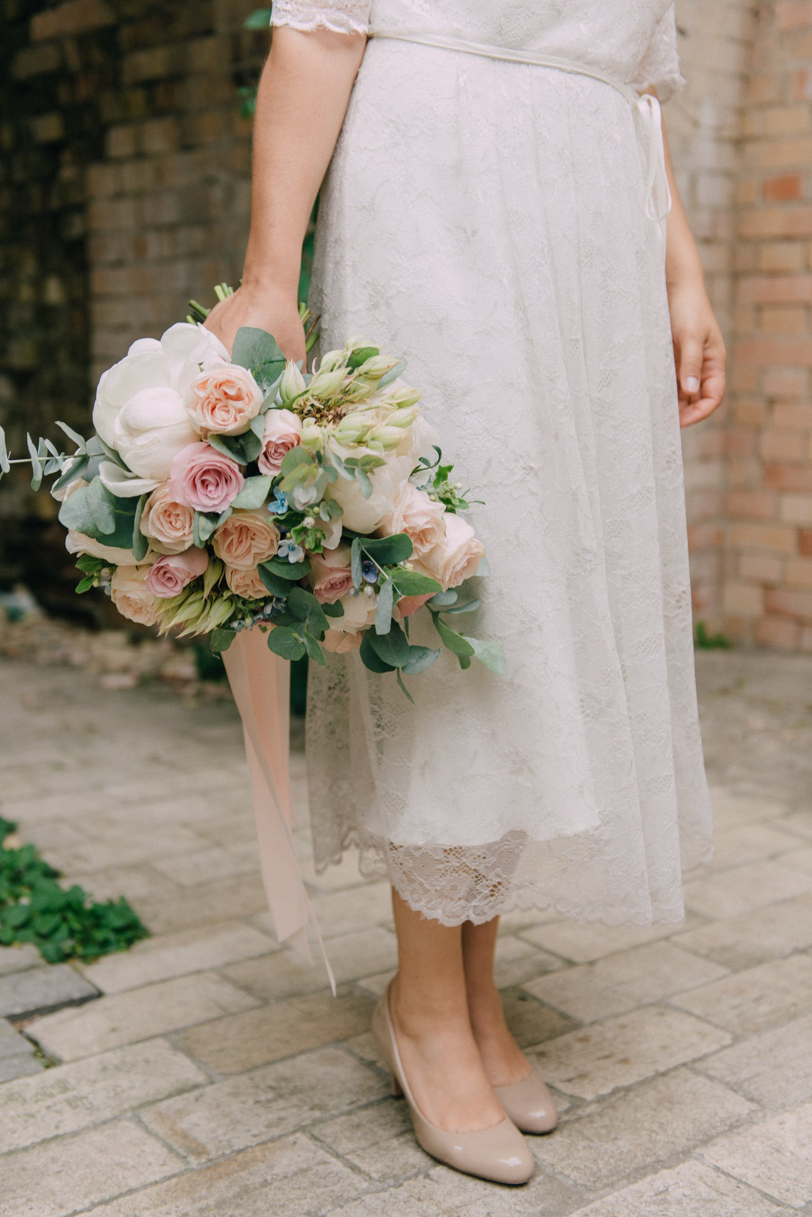 Person Holding Bouquet