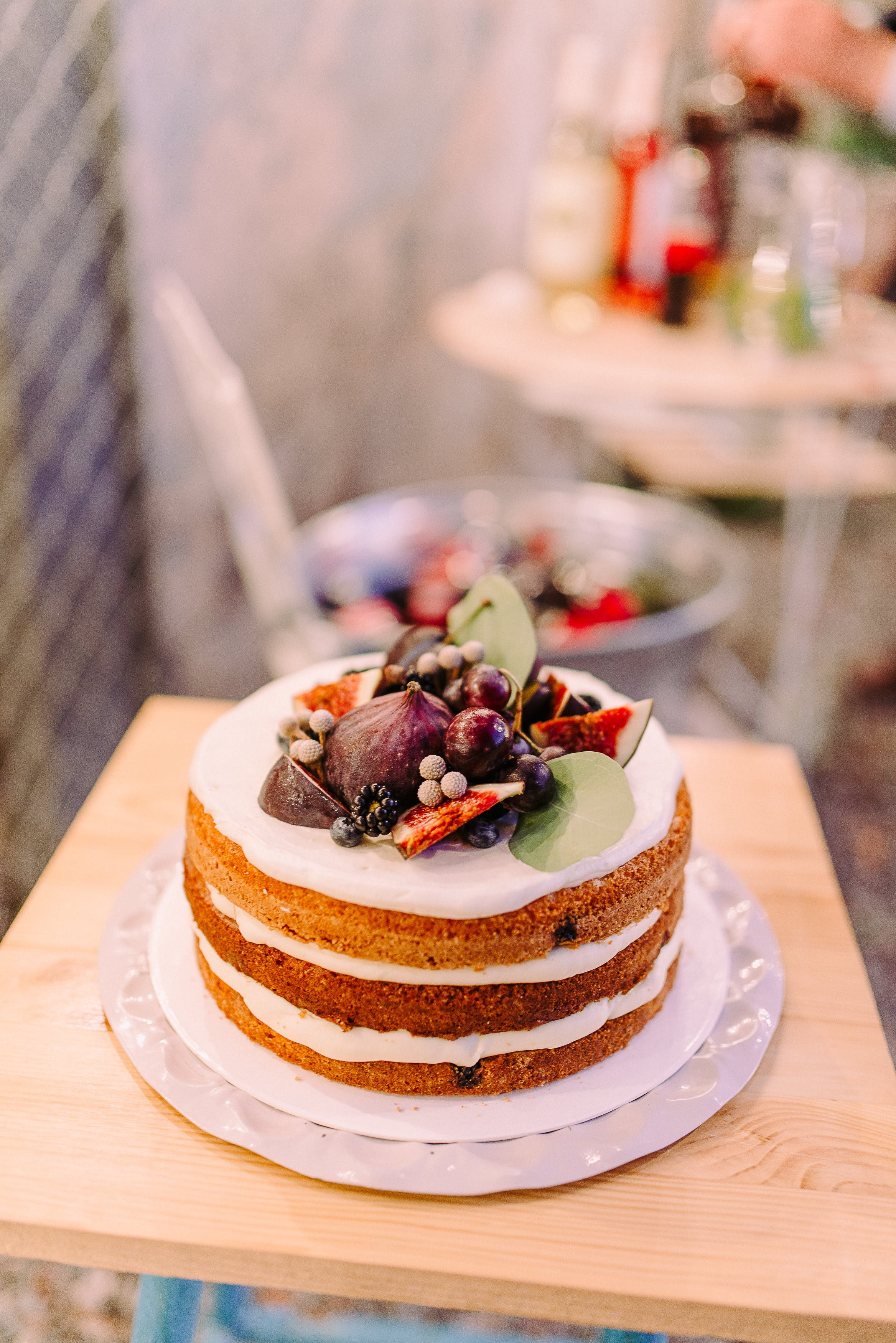 White Icing-covered Cake in Bokeh Photography