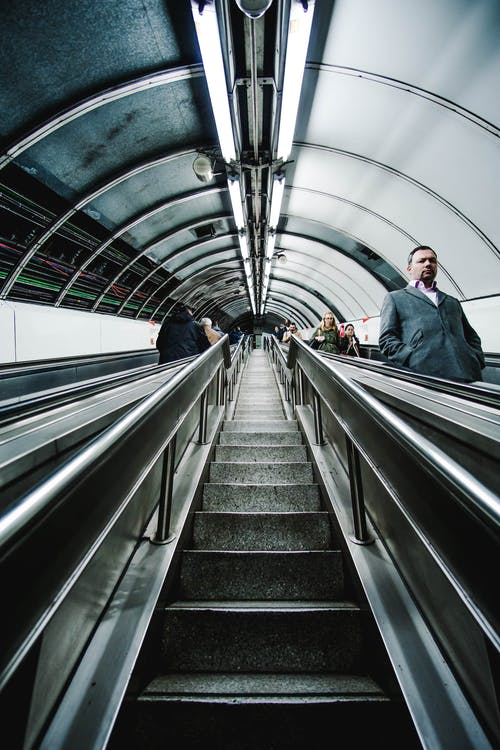 Low-angle Photography of People Riding Escalators
