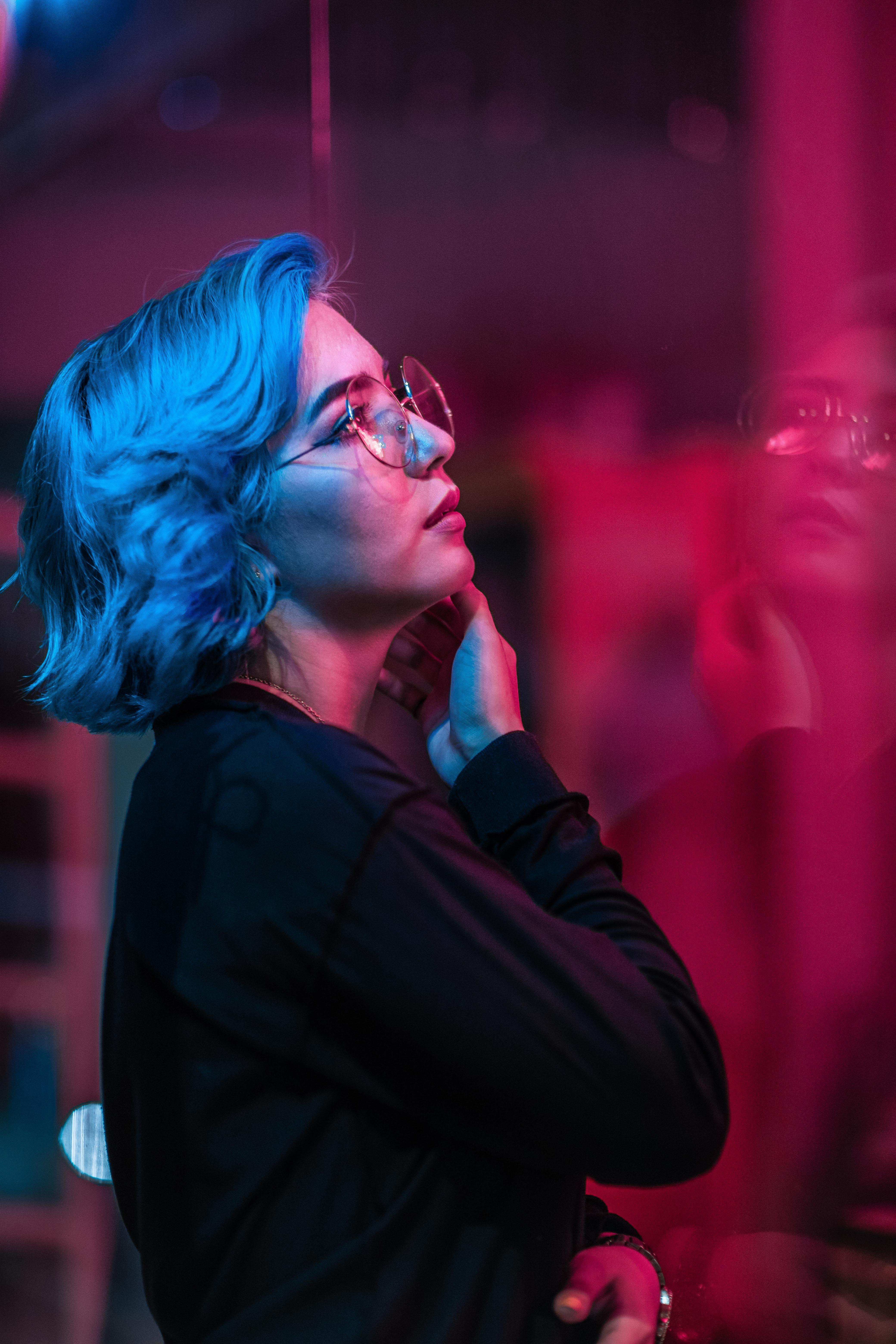 Woman In Black Long-sleeved Top Wearing Eyeglasses