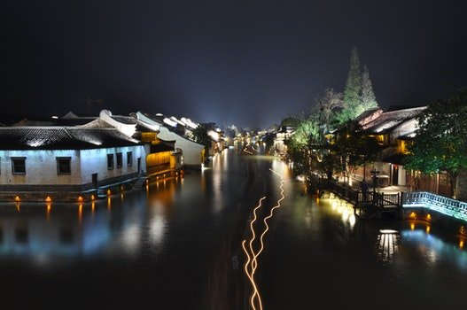 Houses Near a Body of Water during Nigh Time