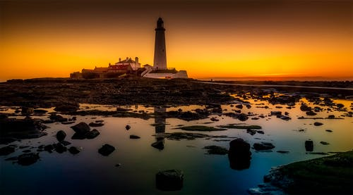 White Lighthouse Under Sunset
