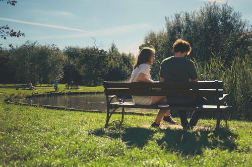 Two Girl and Boy Sitting on Bench Outdoor