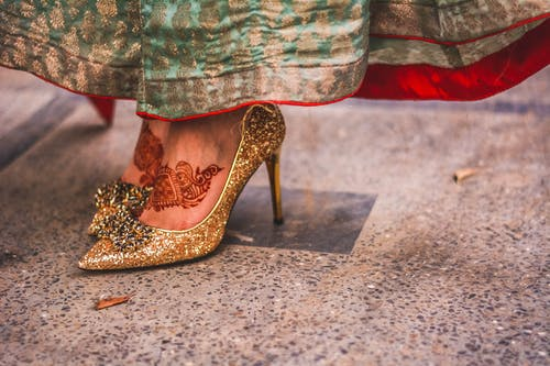 Free stock photo of expensive shoes, feet, female model, gold heels