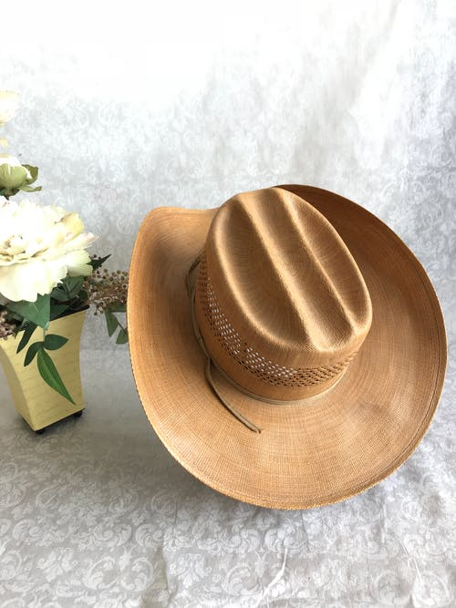 Free stock photo of artificial flowers, cowboy hat, flowers