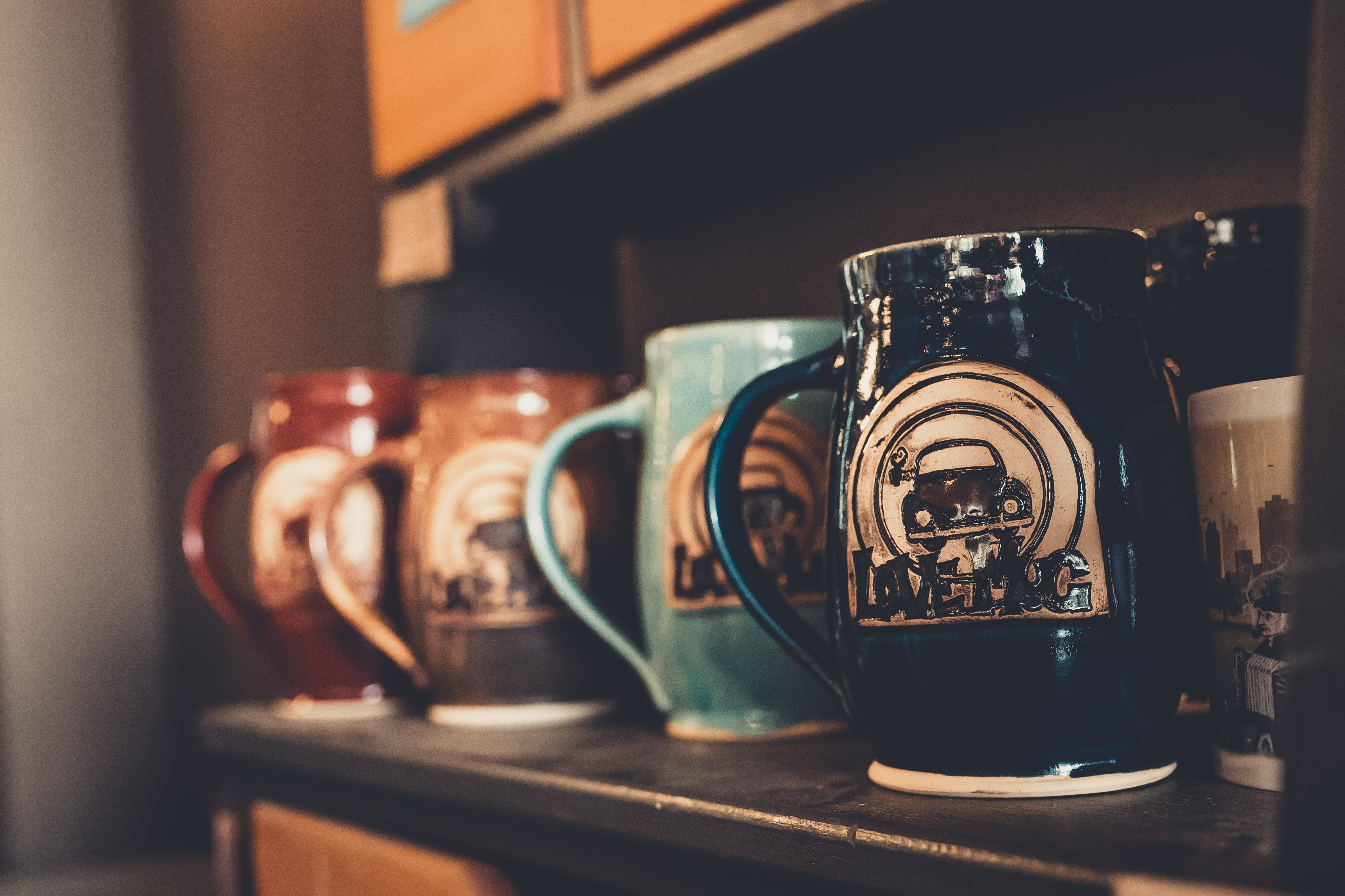 Selective Focus Photography Of Mugs