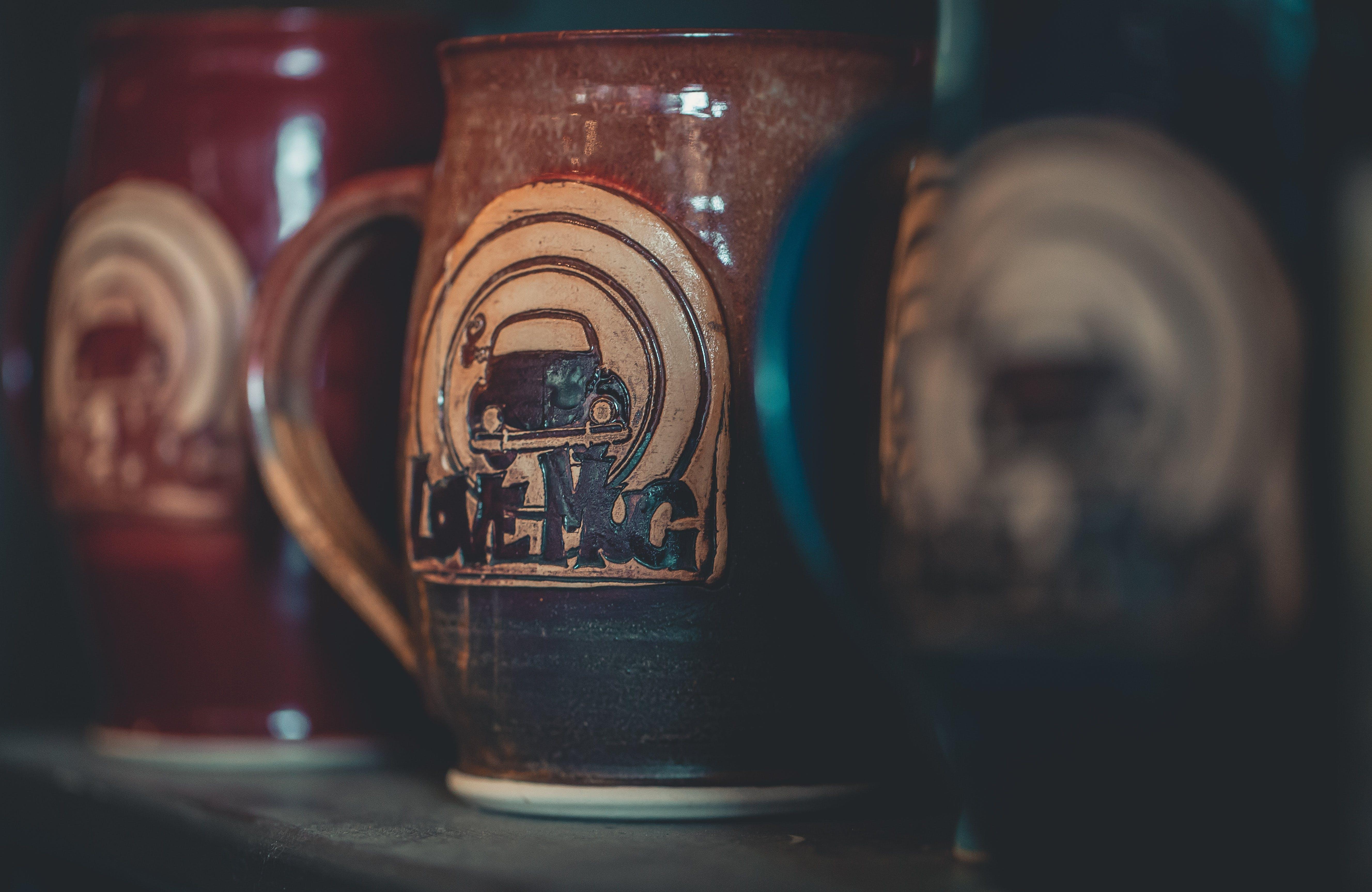 Three Brown Beer Mugs