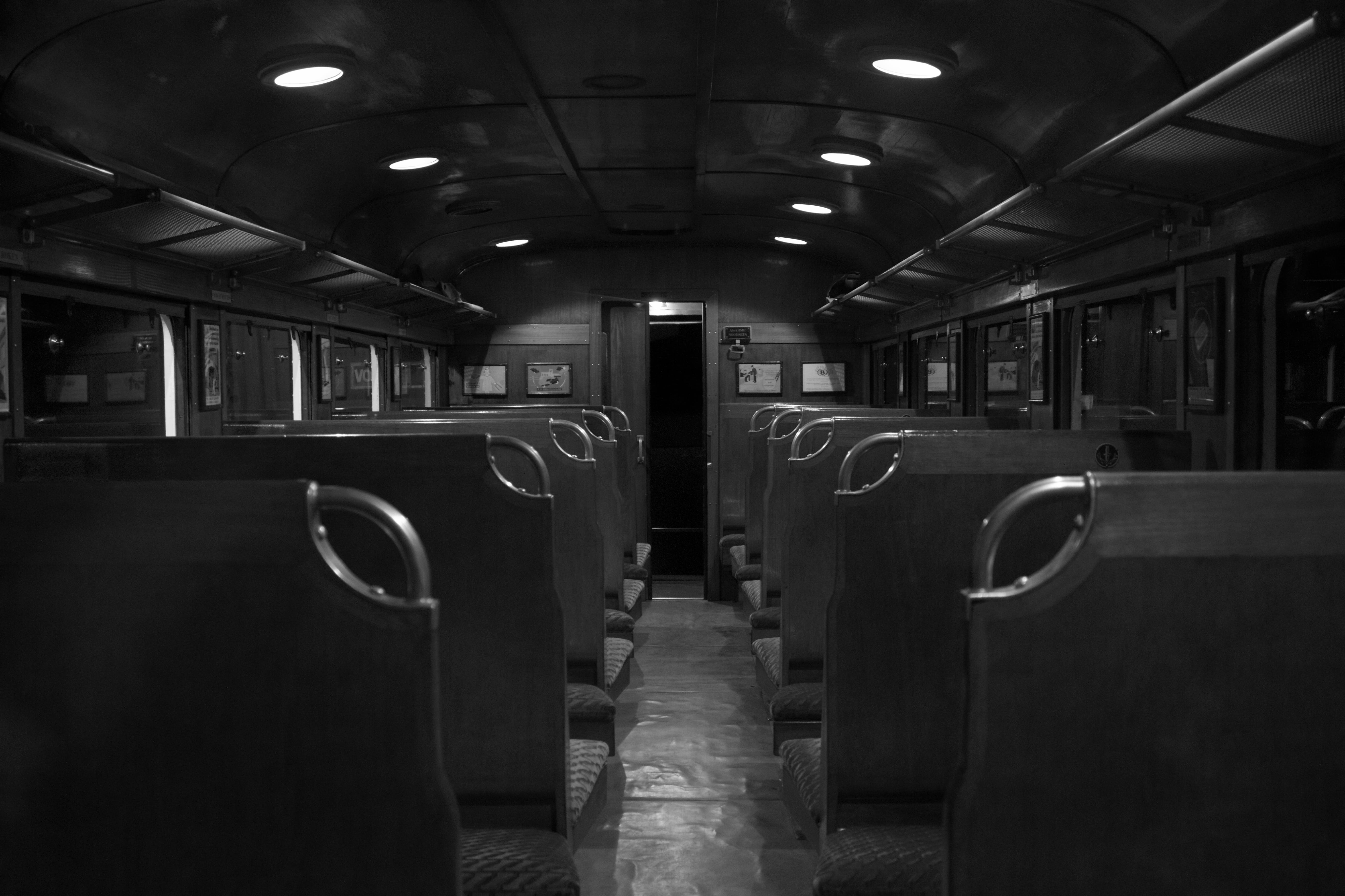 Grayscale Photography of Train Car Interior