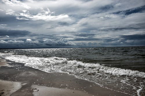 Seashore Under White Clouds