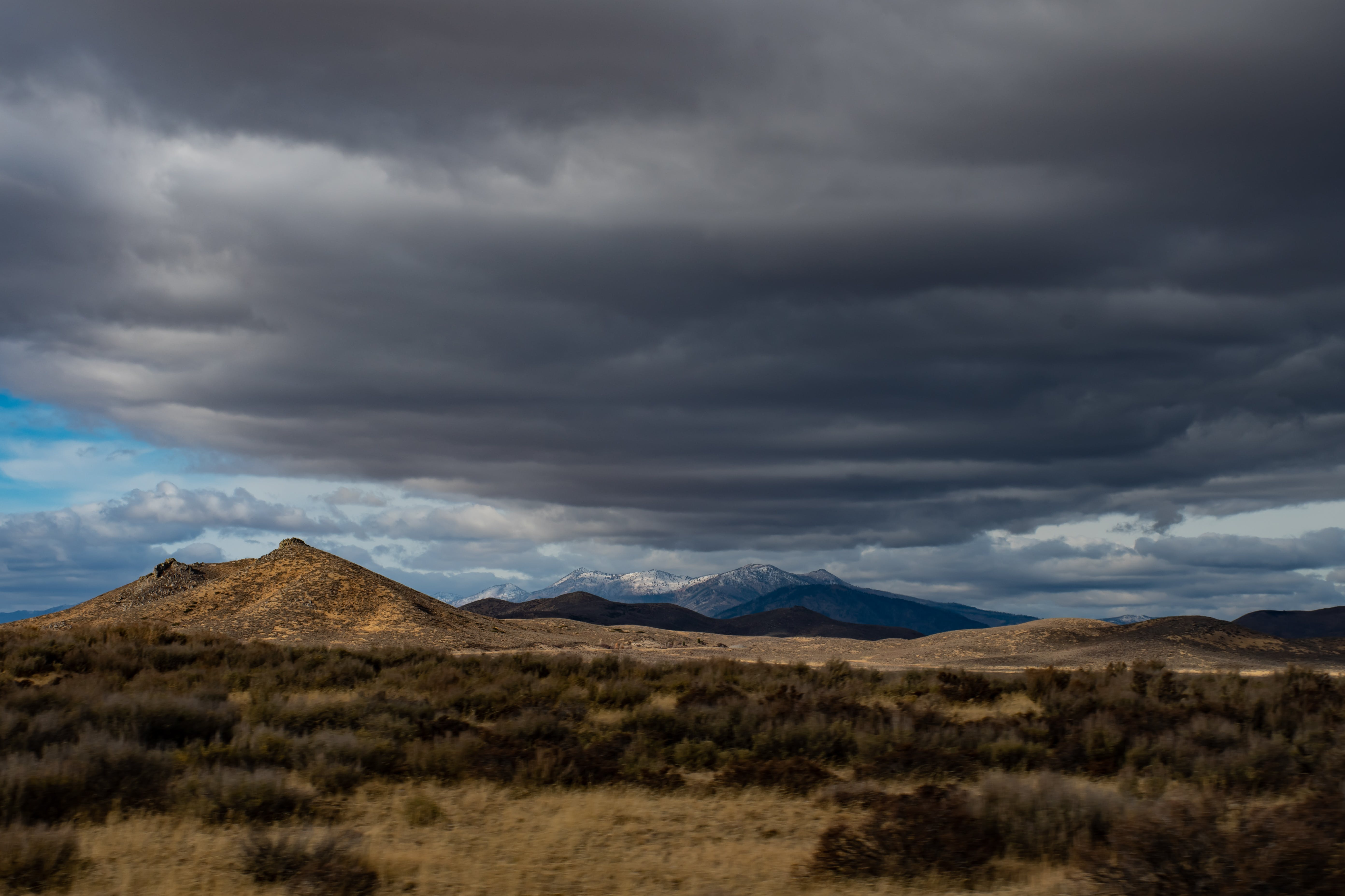 Landscape Photography of Mountains Under Gray Sky