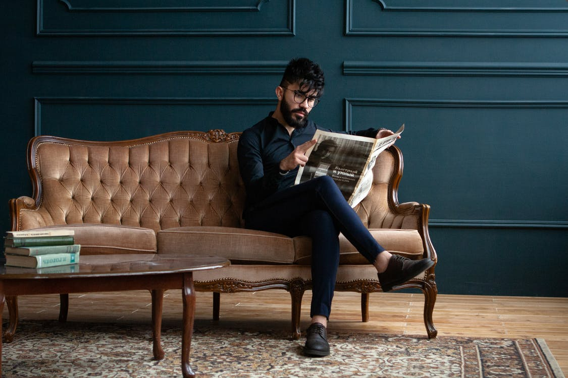 Man Seating On Couch