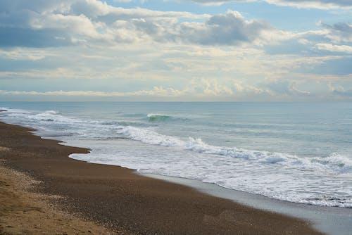 Foto profissional grátis de à beira-mar, areia, beira-mar, horizonte
