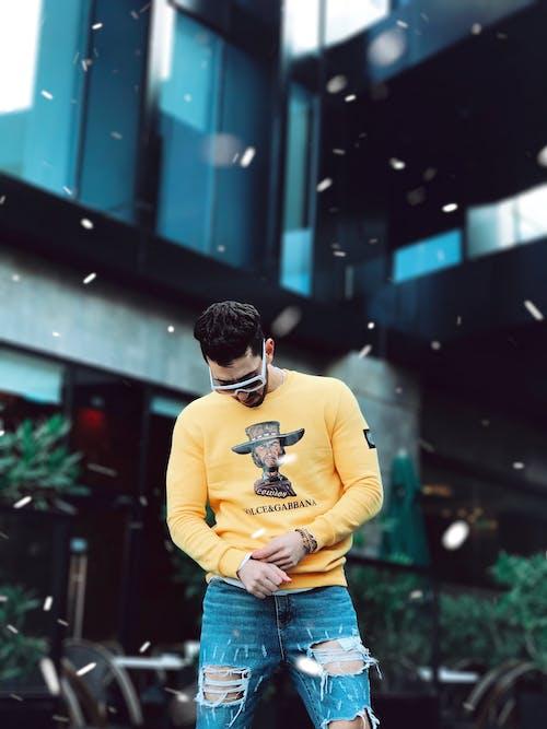 Photo of Man in Yellow Long-sleeved Sweatshirt Standing Outdoor