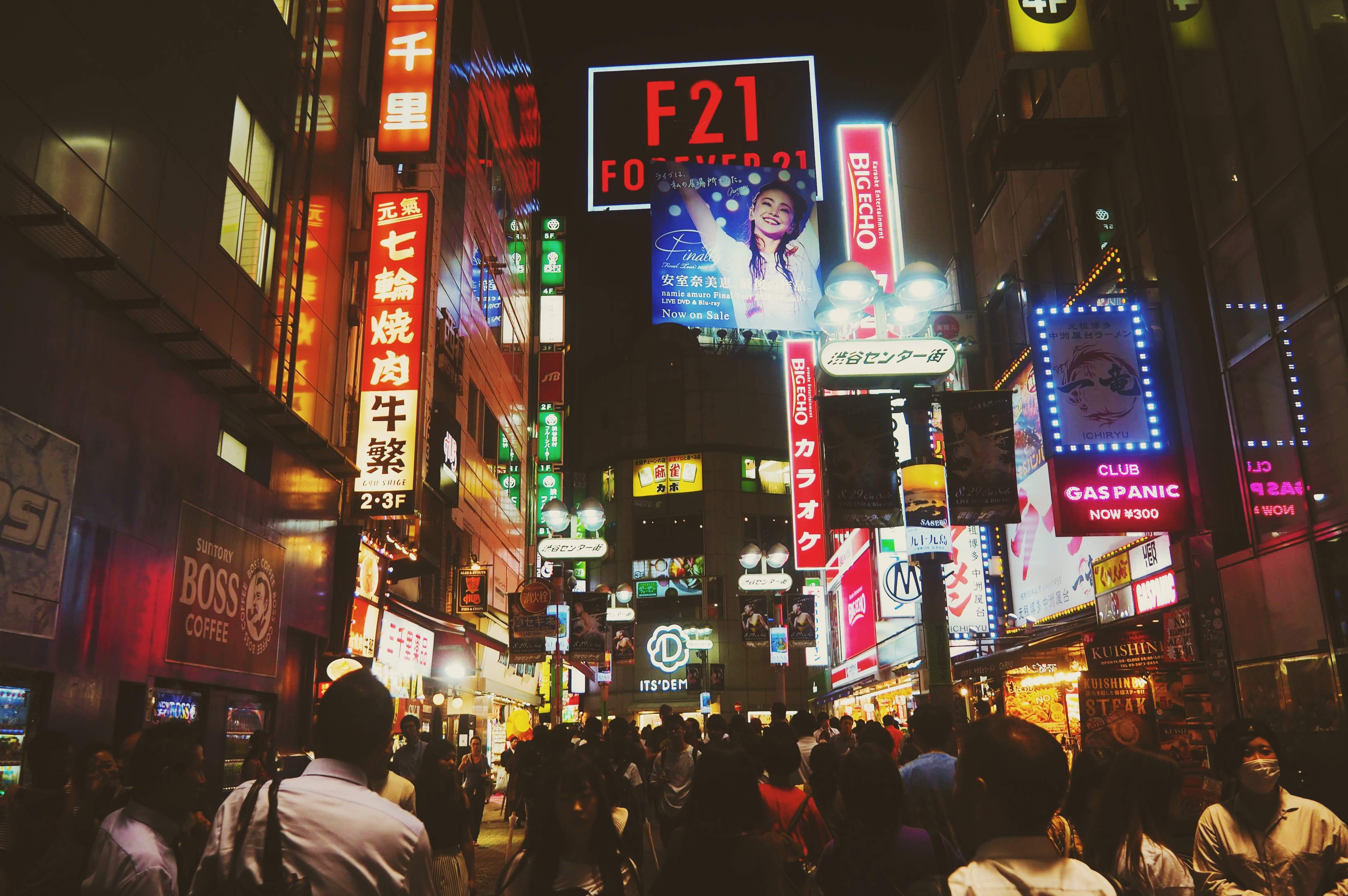 Crowd of People Under Neon Signs