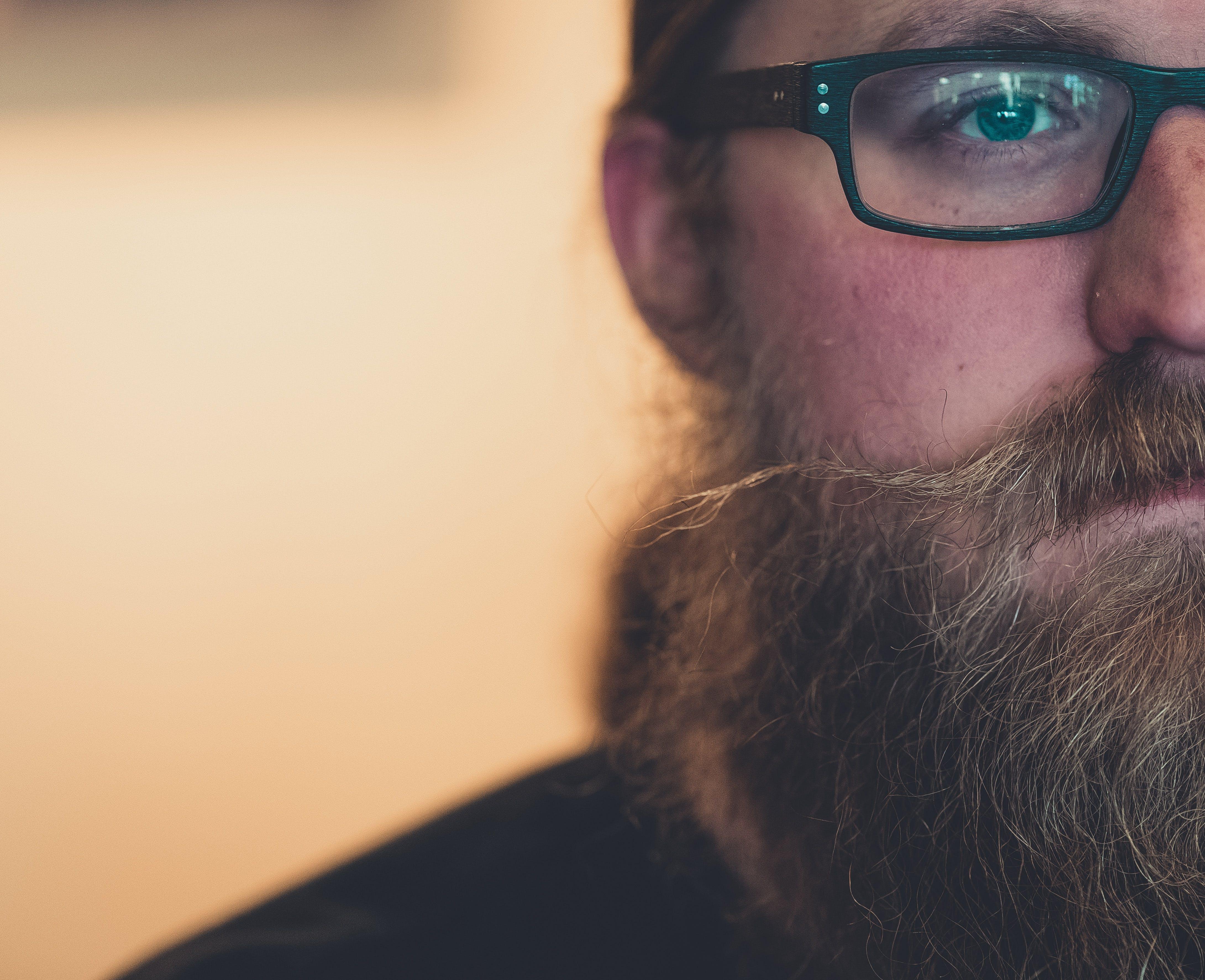 Close-Up Photo of Man Wearing Eyeglasses