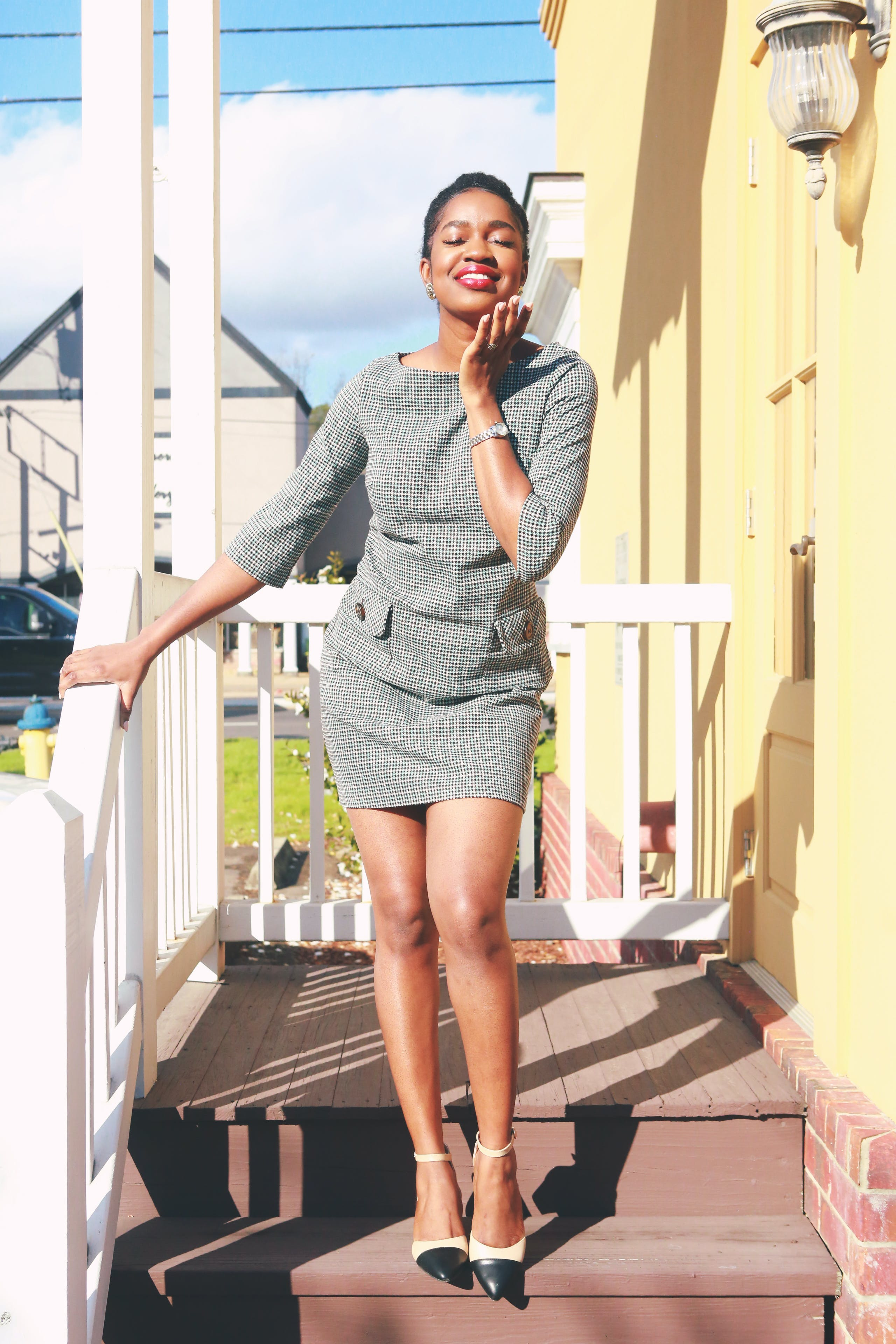 Woman In Grey Quarter Sleeved Blouse And Skirt
