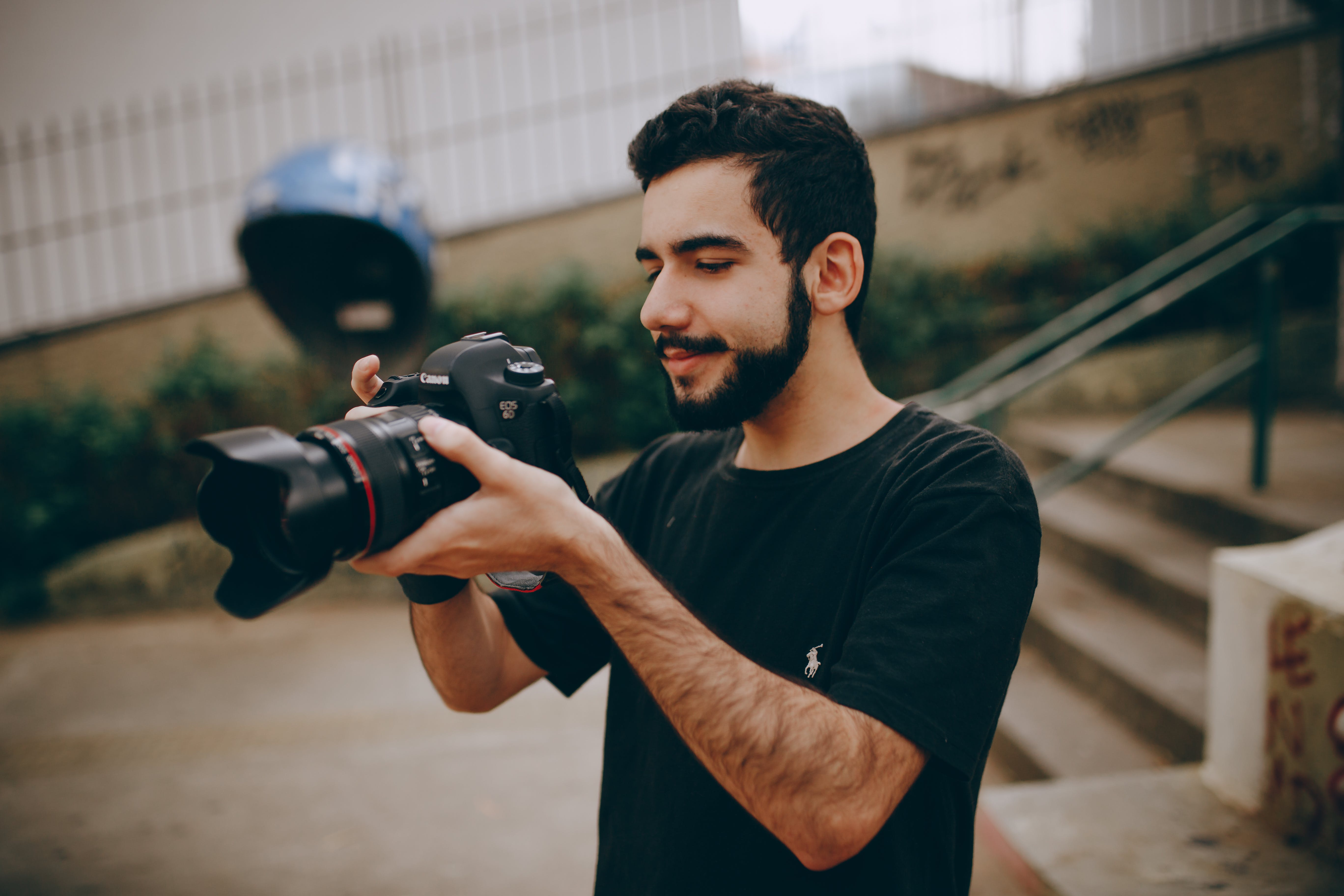 Photo of Man Taking Photo Using a Dslr Camera
