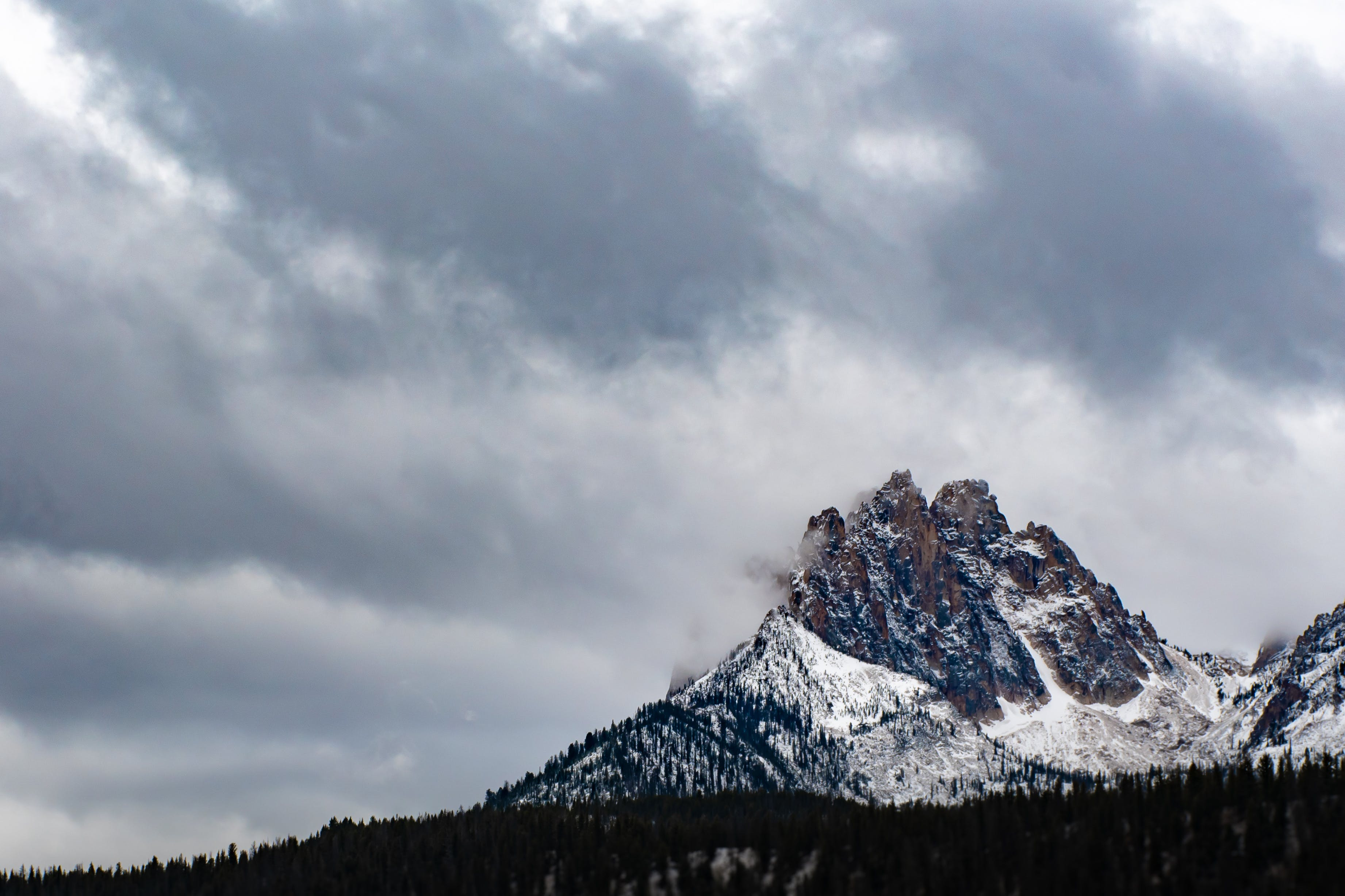 Gray and White Mountain Under Gray Clouds