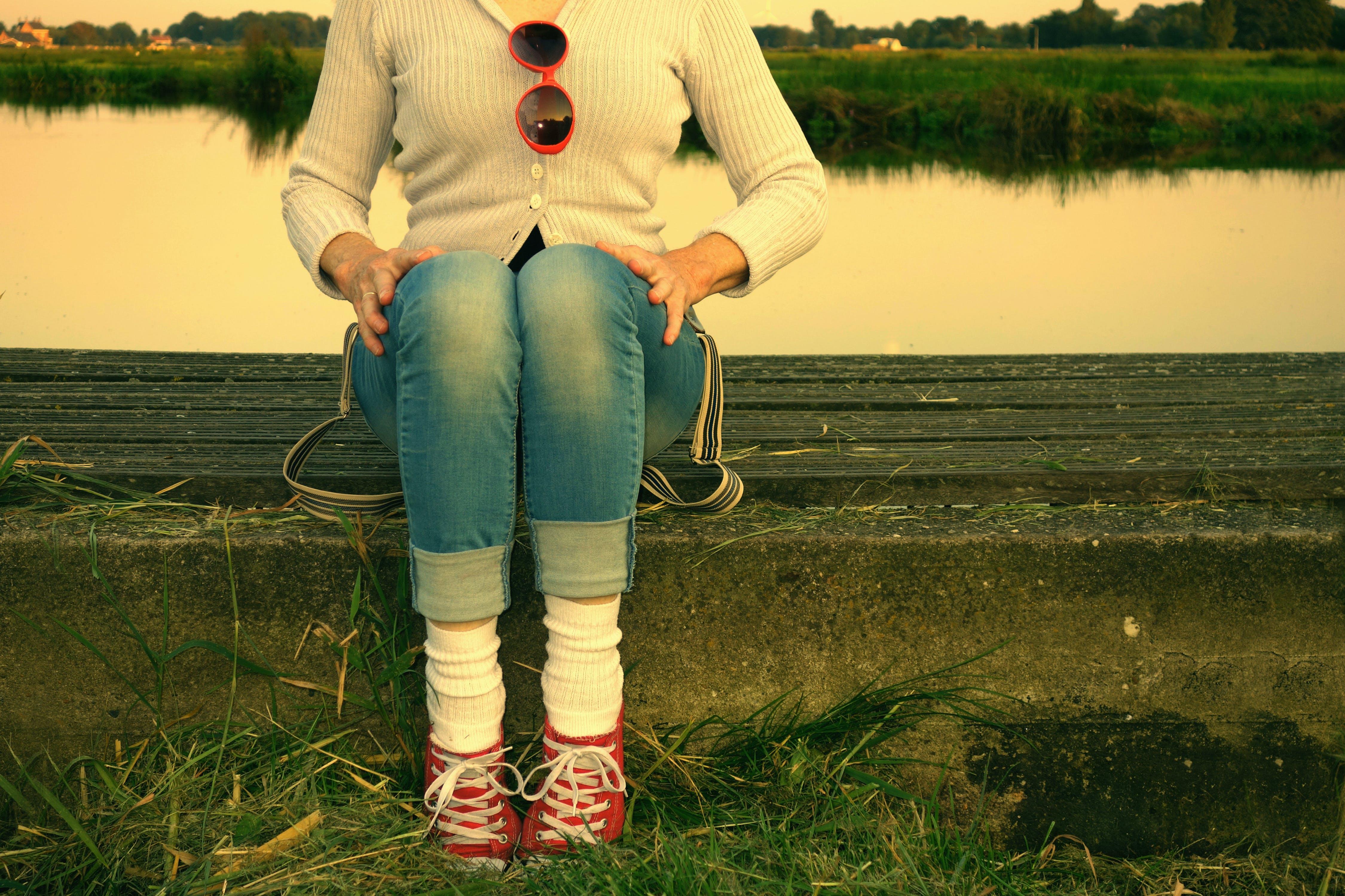 cardigan, jeans, natural setting