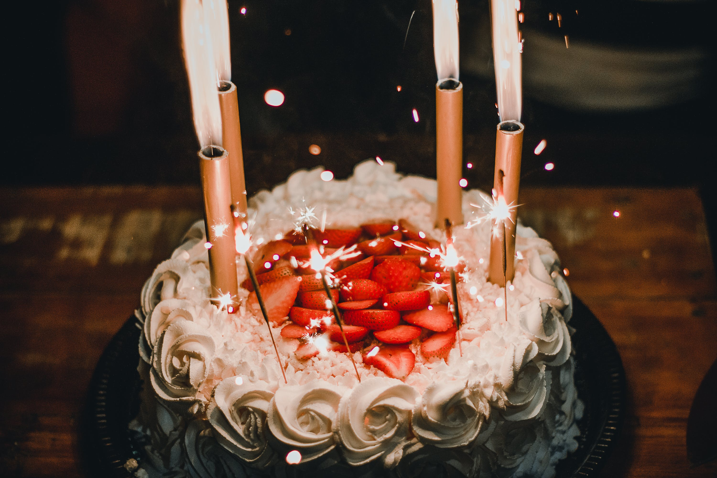 Lighted Candles on White Icing-covered Cake